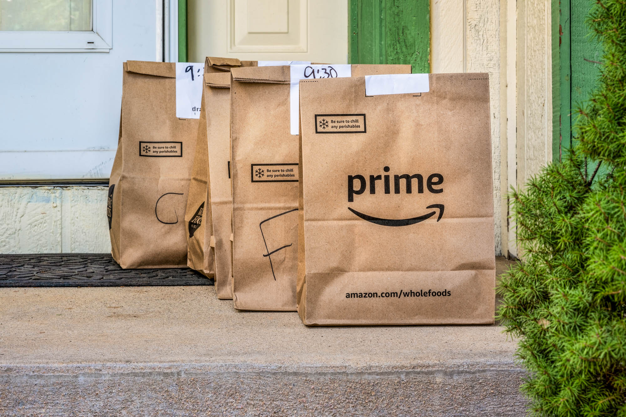 Amazon Prime Delivery Bags on a doorstep