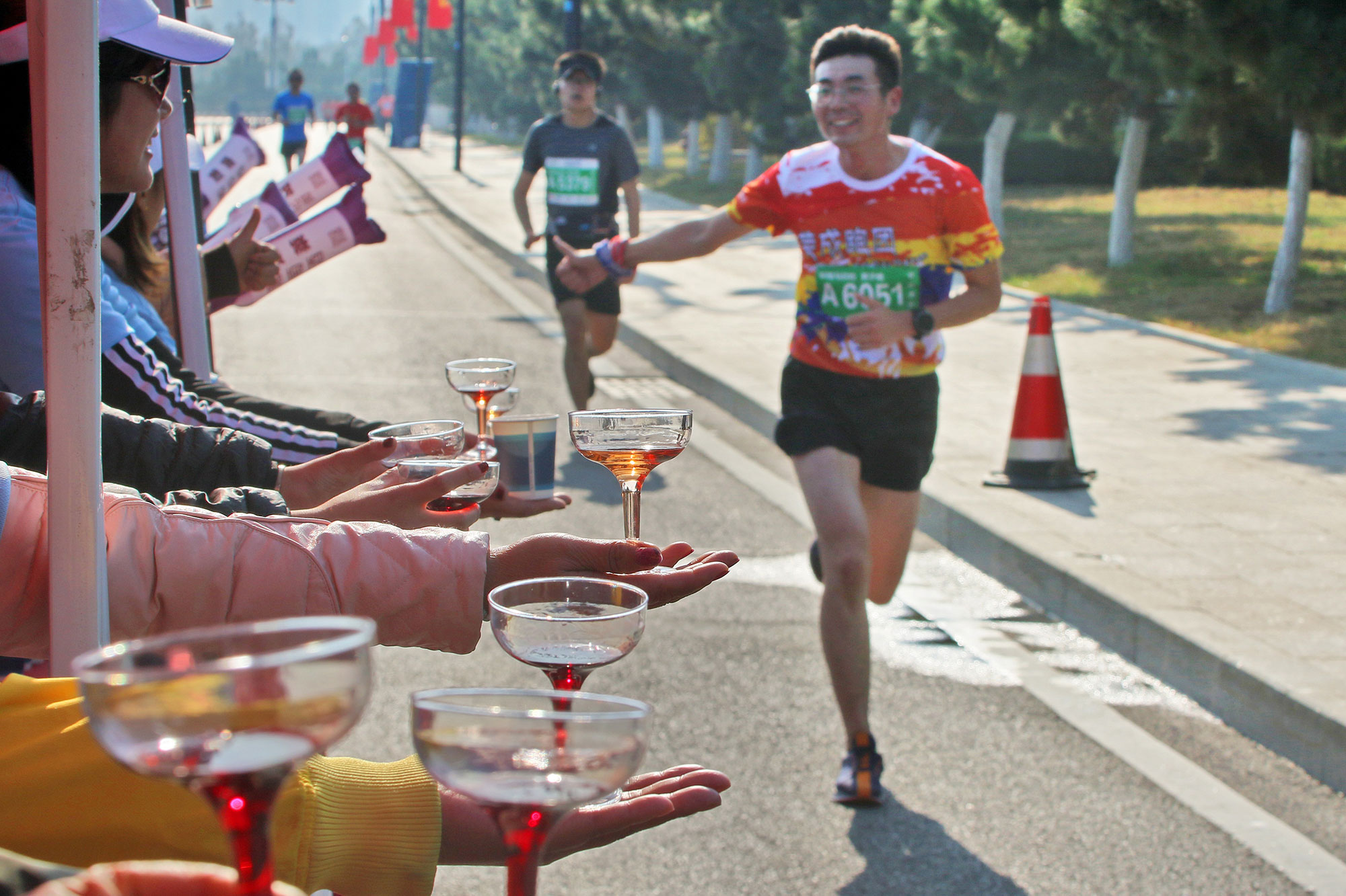 The marathon runner are enjoying grape wine and seafood at 2019 Penglai Wine International Marathon in Yantai,Shandong,China on 27th October, 2019