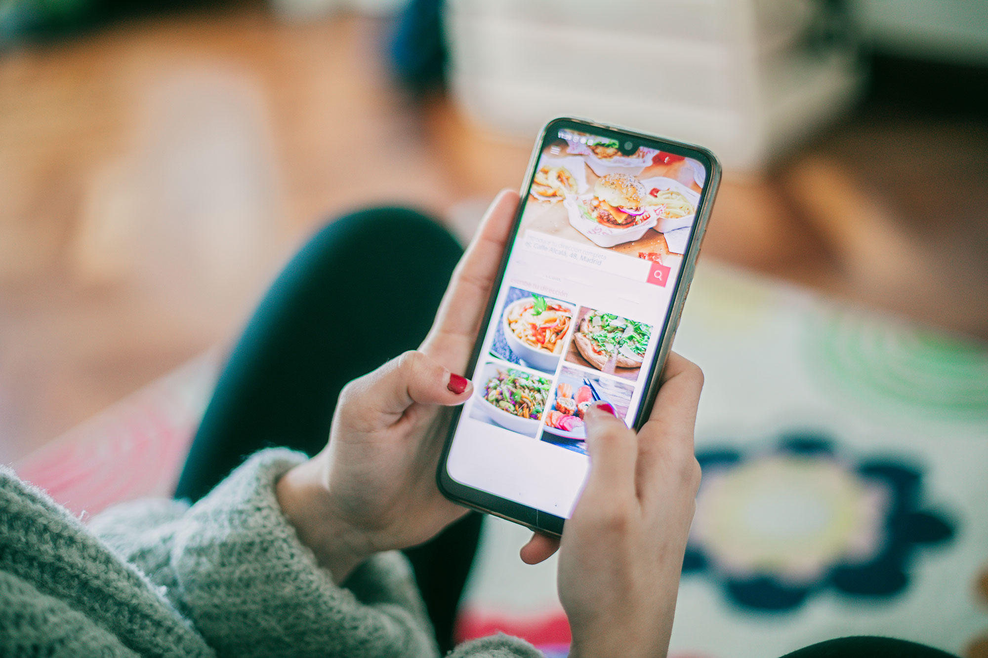 Woman using meal delivery service through mobile app.