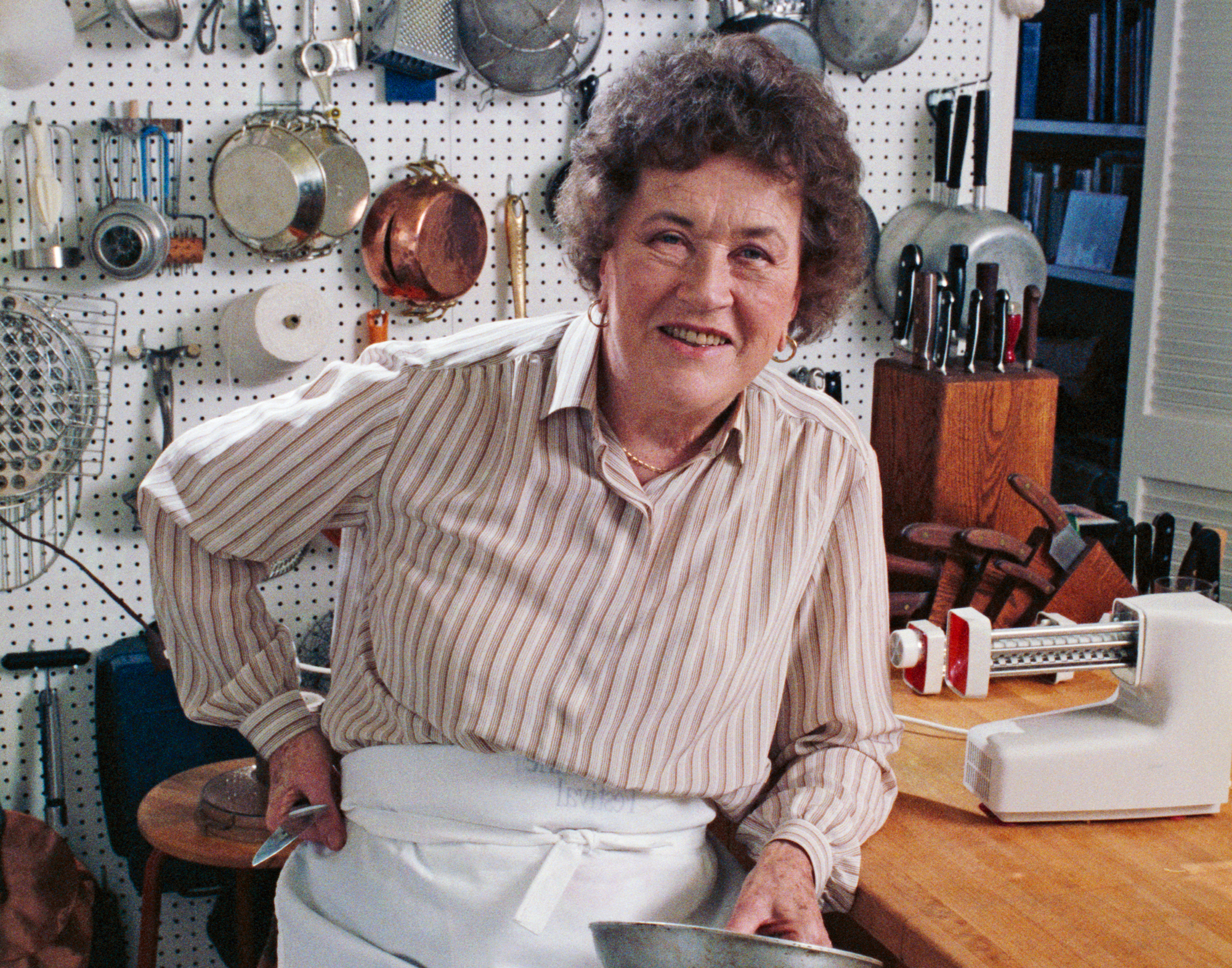 Julia Child Posing in her Kitchen