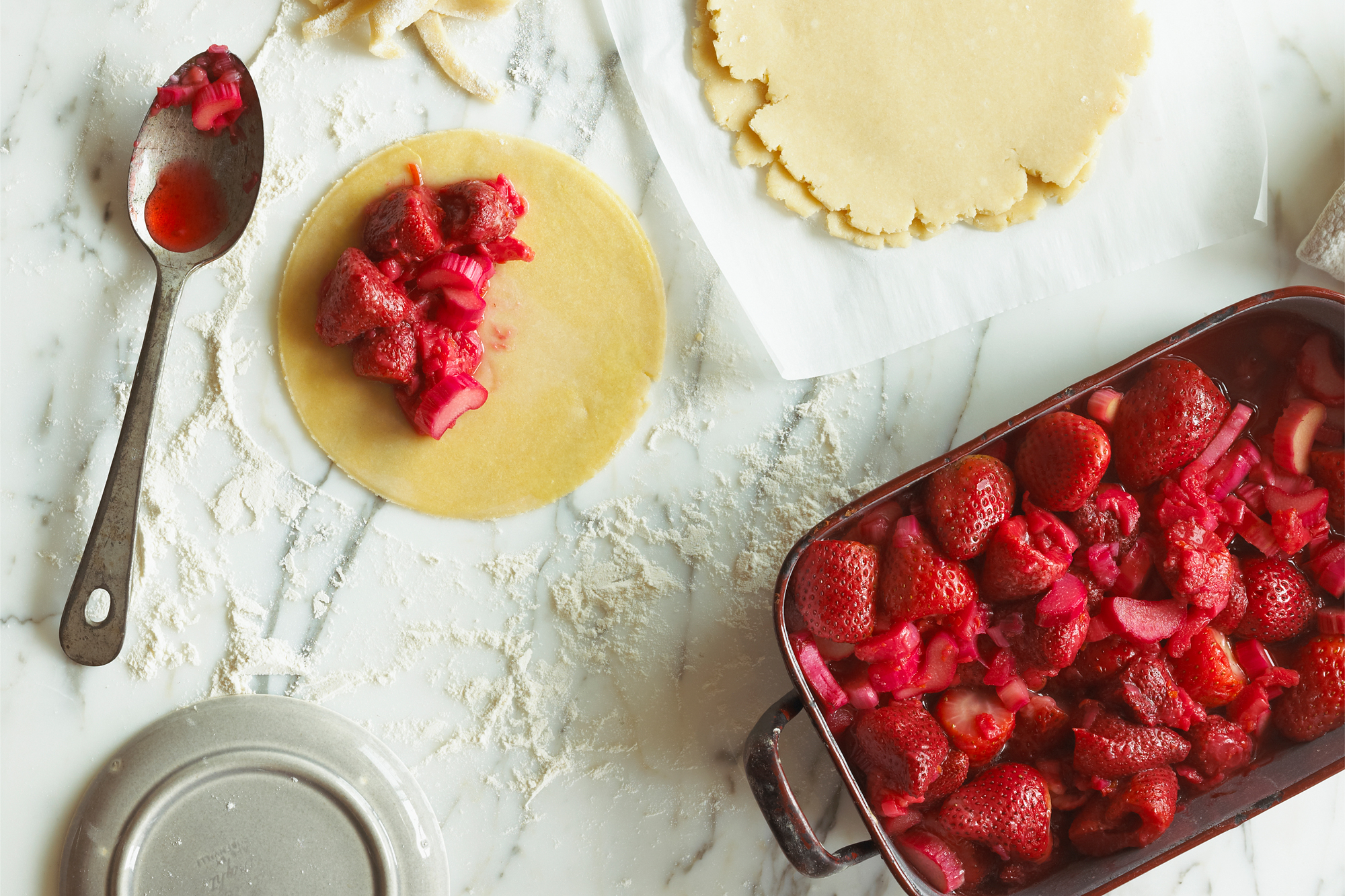 marble countertop with strawberry hand pies
