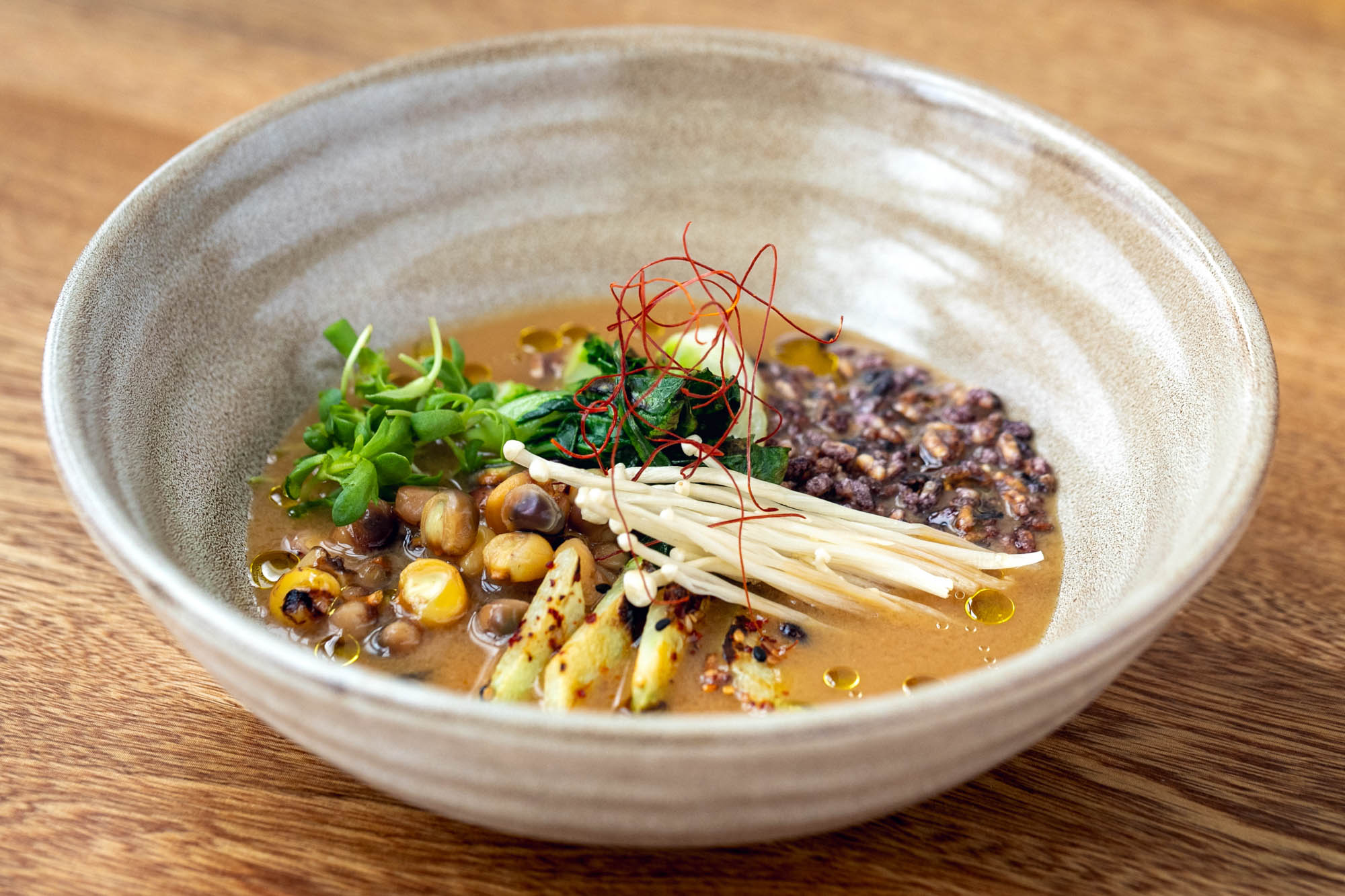 Sooki & Mimi pozole with doenjang, potawatomi flint corn, puffed rice, chayote, enoki