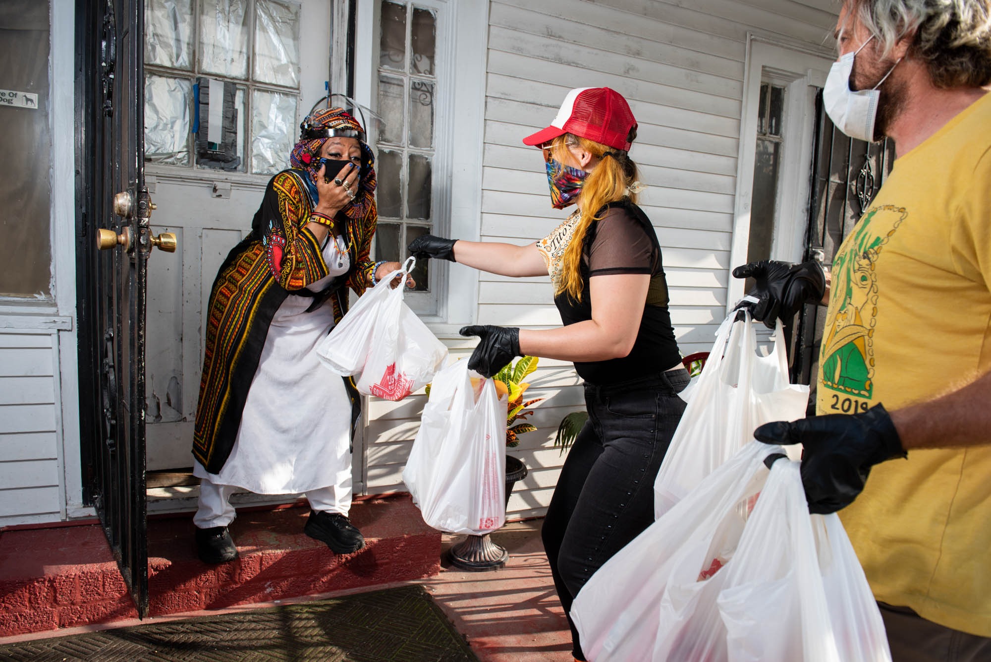 """Cate and Tyler deliver groceries to Resa """"Queen Cinnamon Black"""" Bazile for Feed the Second Line"""