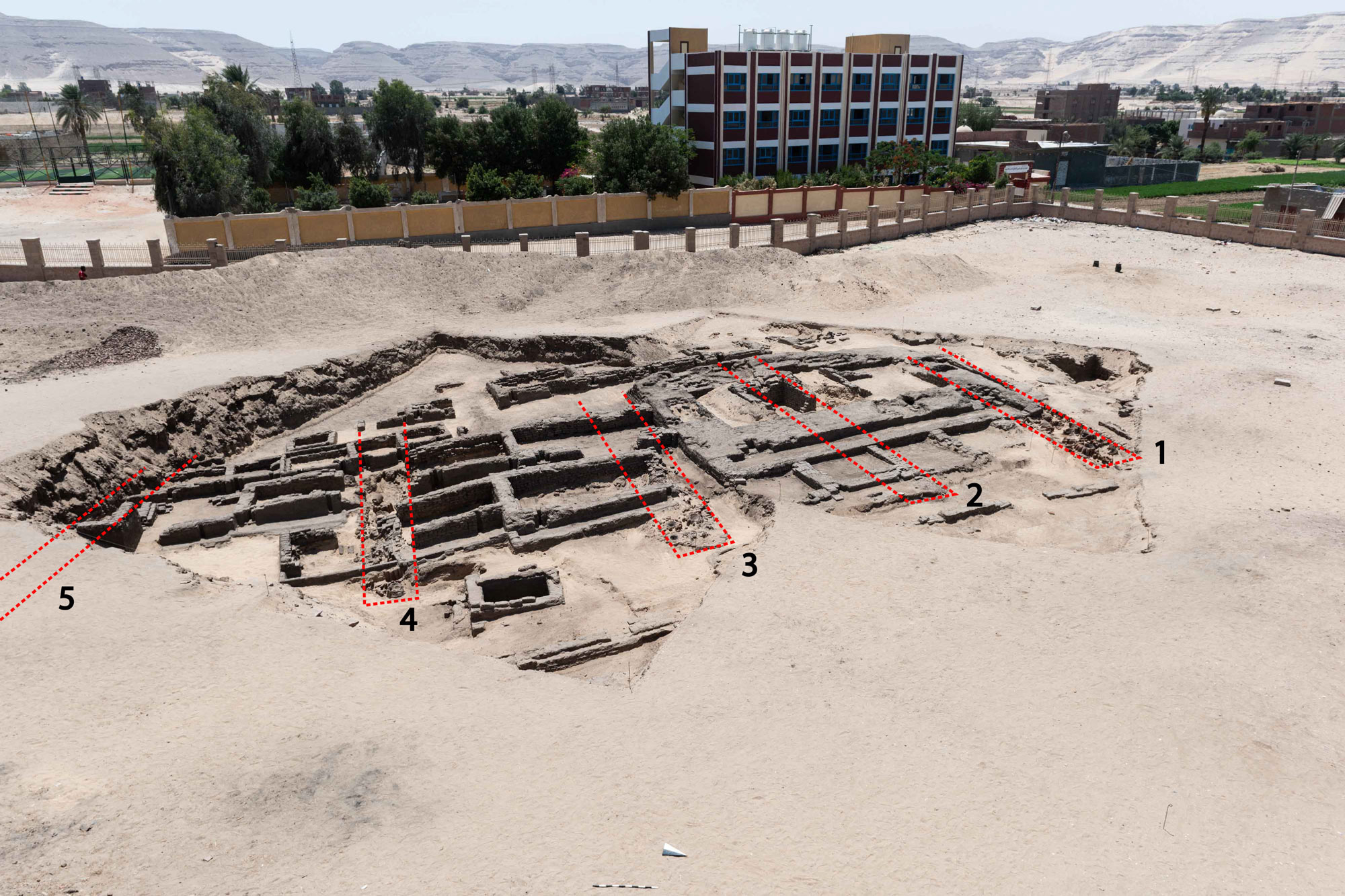 "2018 excavations in ""Cemetery D,"" with mudbrick tomb superstructures of the early Old Kingdom (ca. 2650 BCE) overlying five earlier brewery structures (nos. 1–5), highlighted."