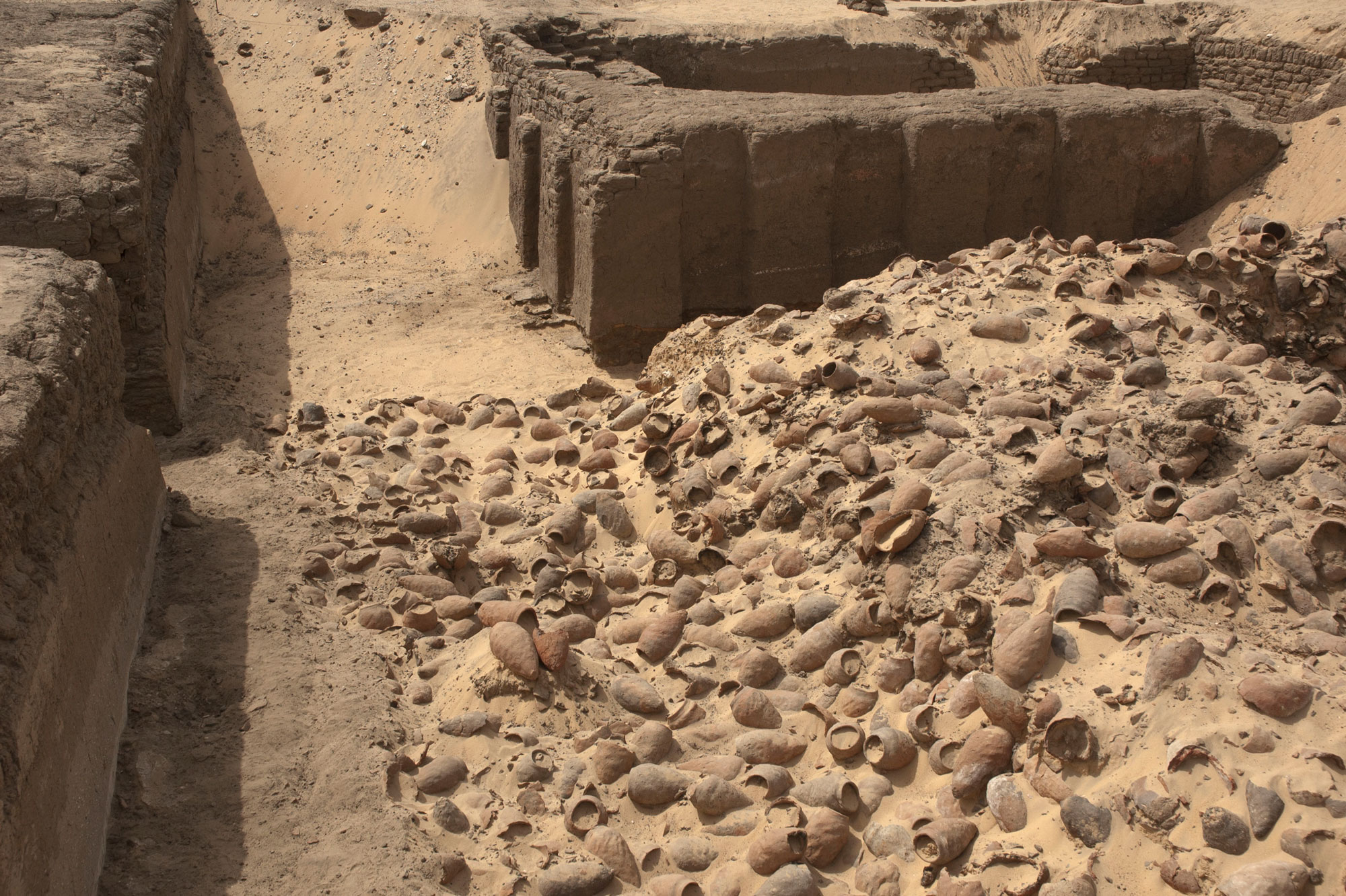 Detail of the deposit of beer jars in front of the east corner gateway of the enclosure of King Peribsen (ca. 2800 BCE).