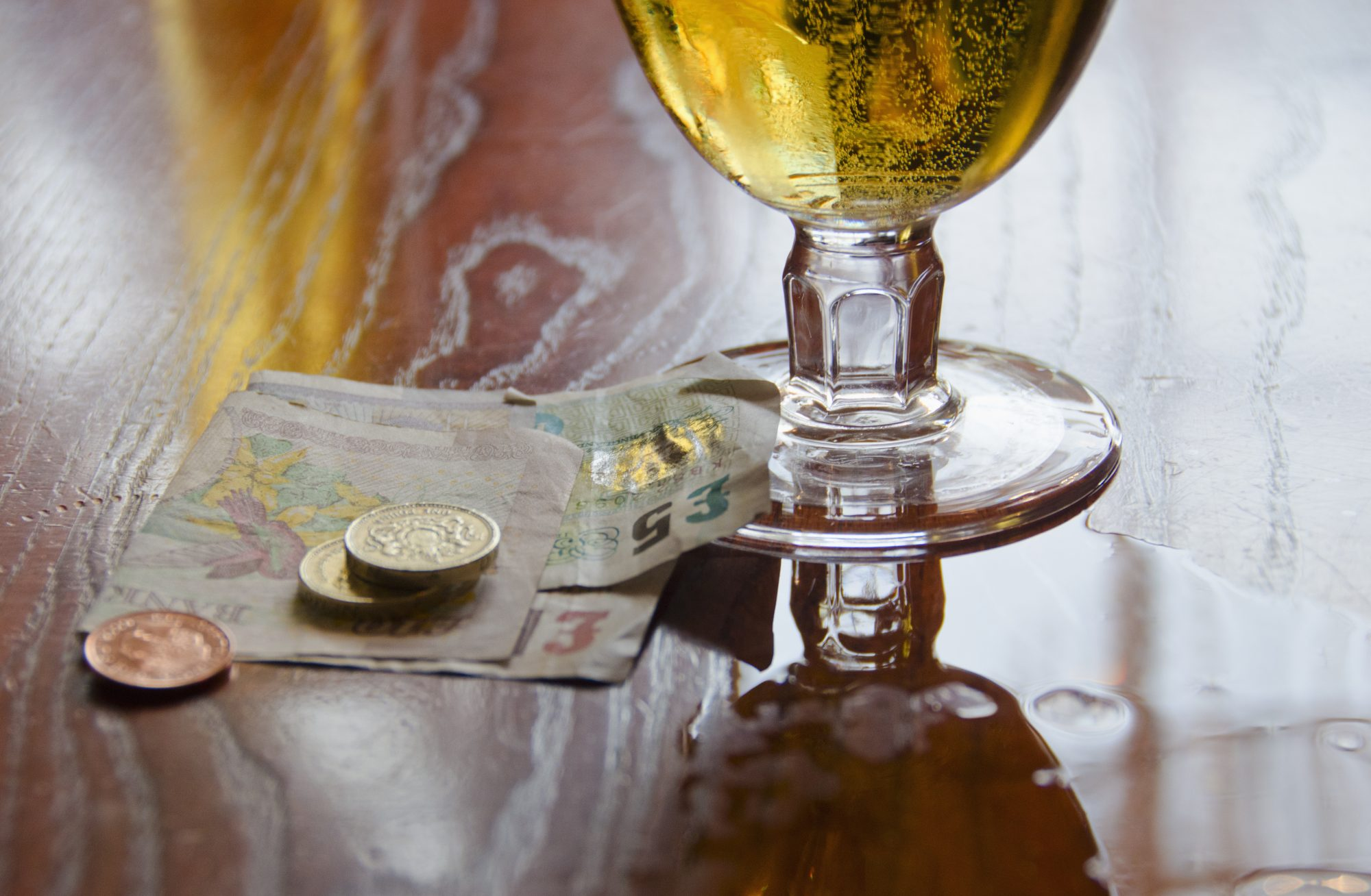 United Kingdom, Bristol, british currency and beer on table