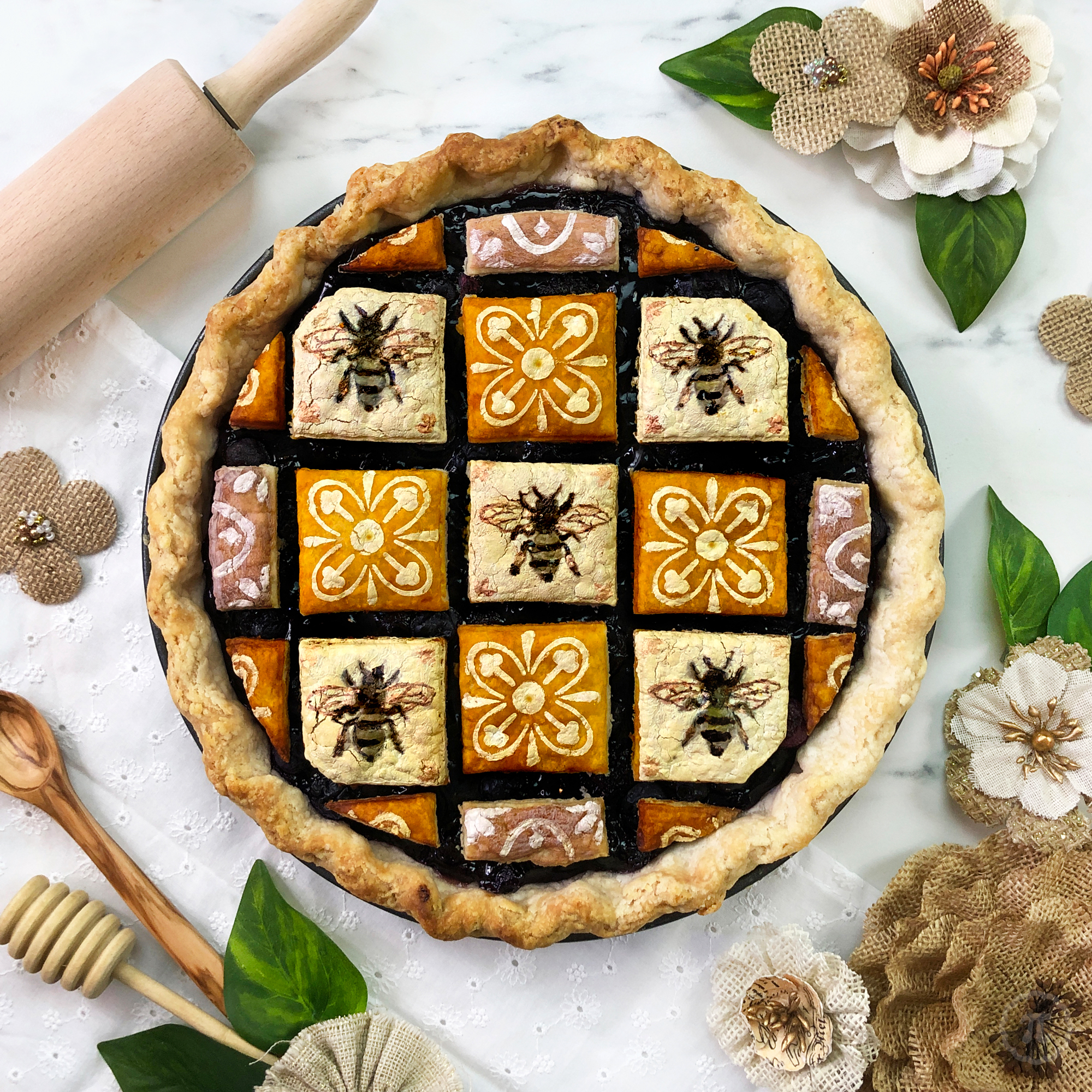 Pie with stenciled pattern of bees