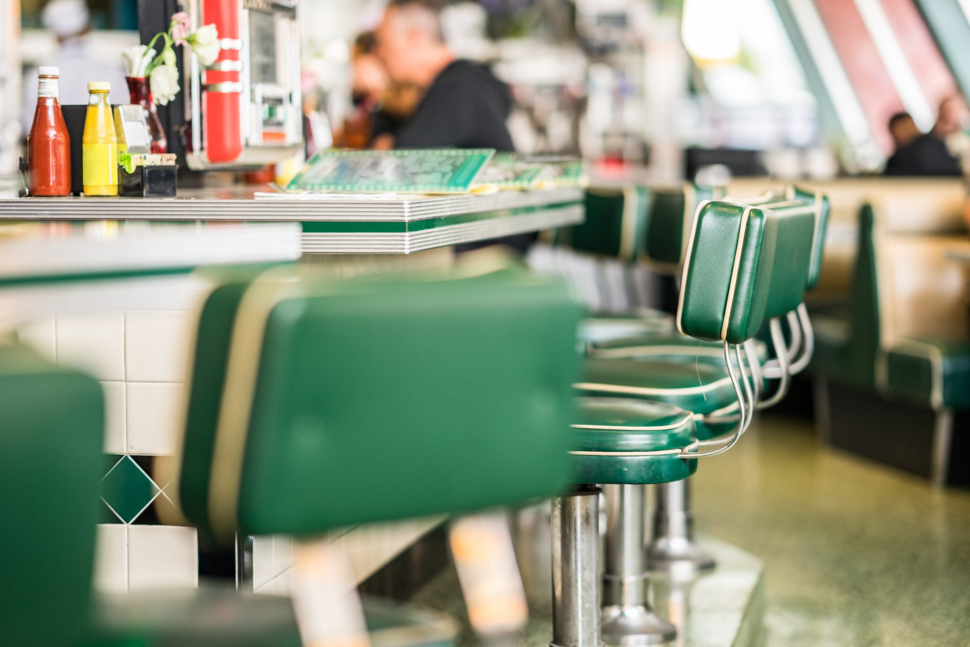 Vintage padded bar stools in an American diner restaurant.