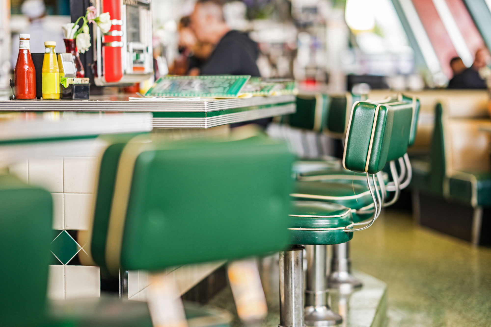 Chrome and green leather details in a drive-in retro eatery