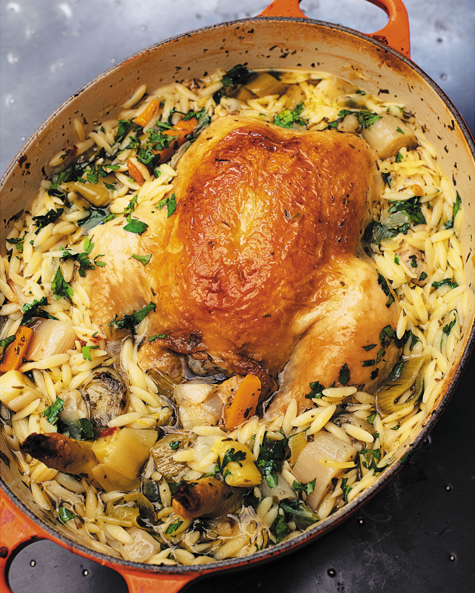 Chicken in a pot with orzo and lemon