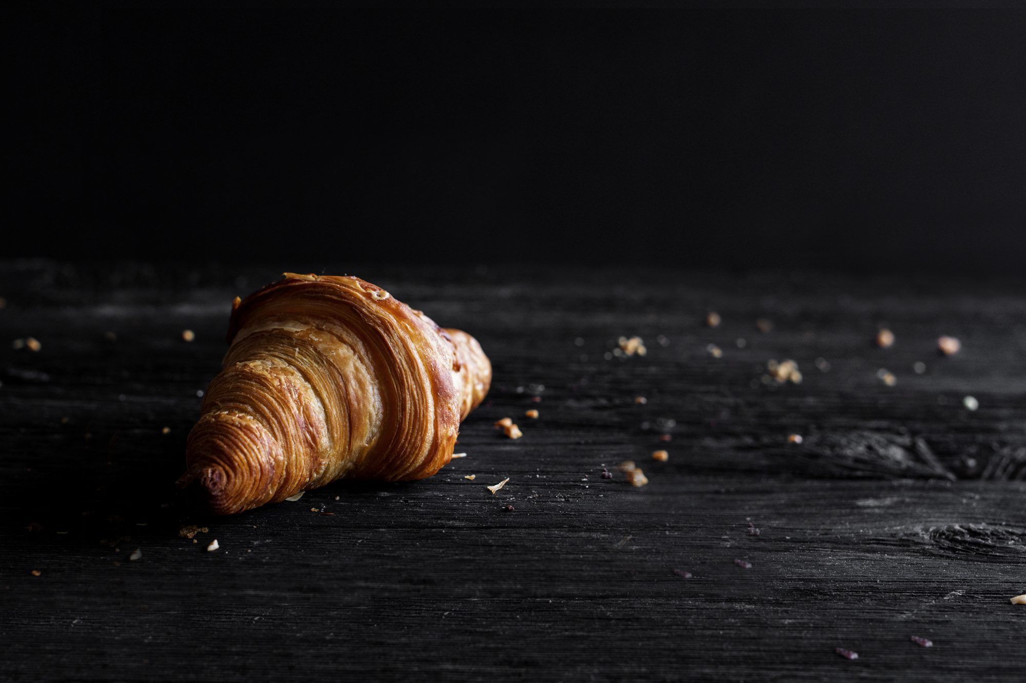 Croissant on wooden background