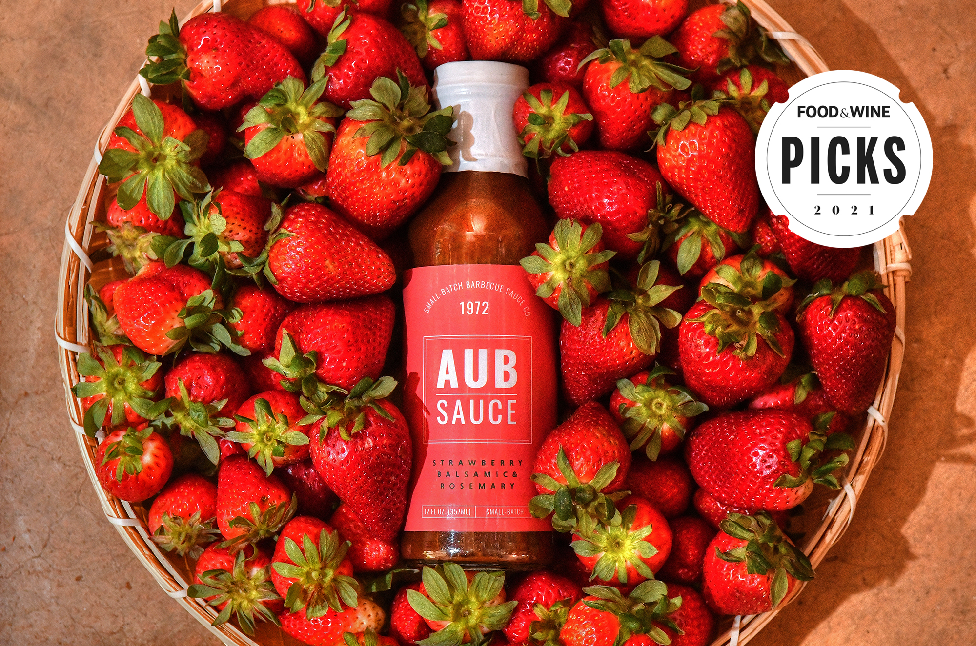 Aub Sauce in basket of strawberries