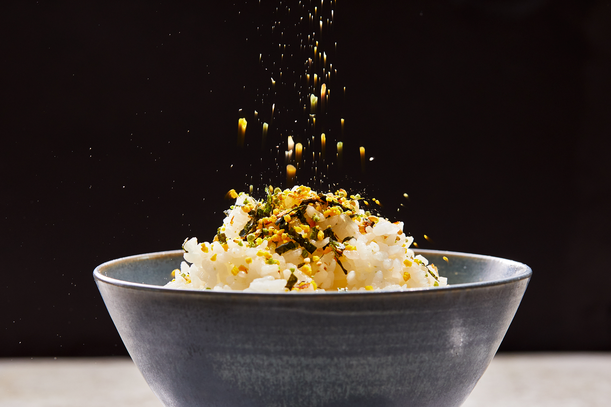 Furikake sprinkling onto rice