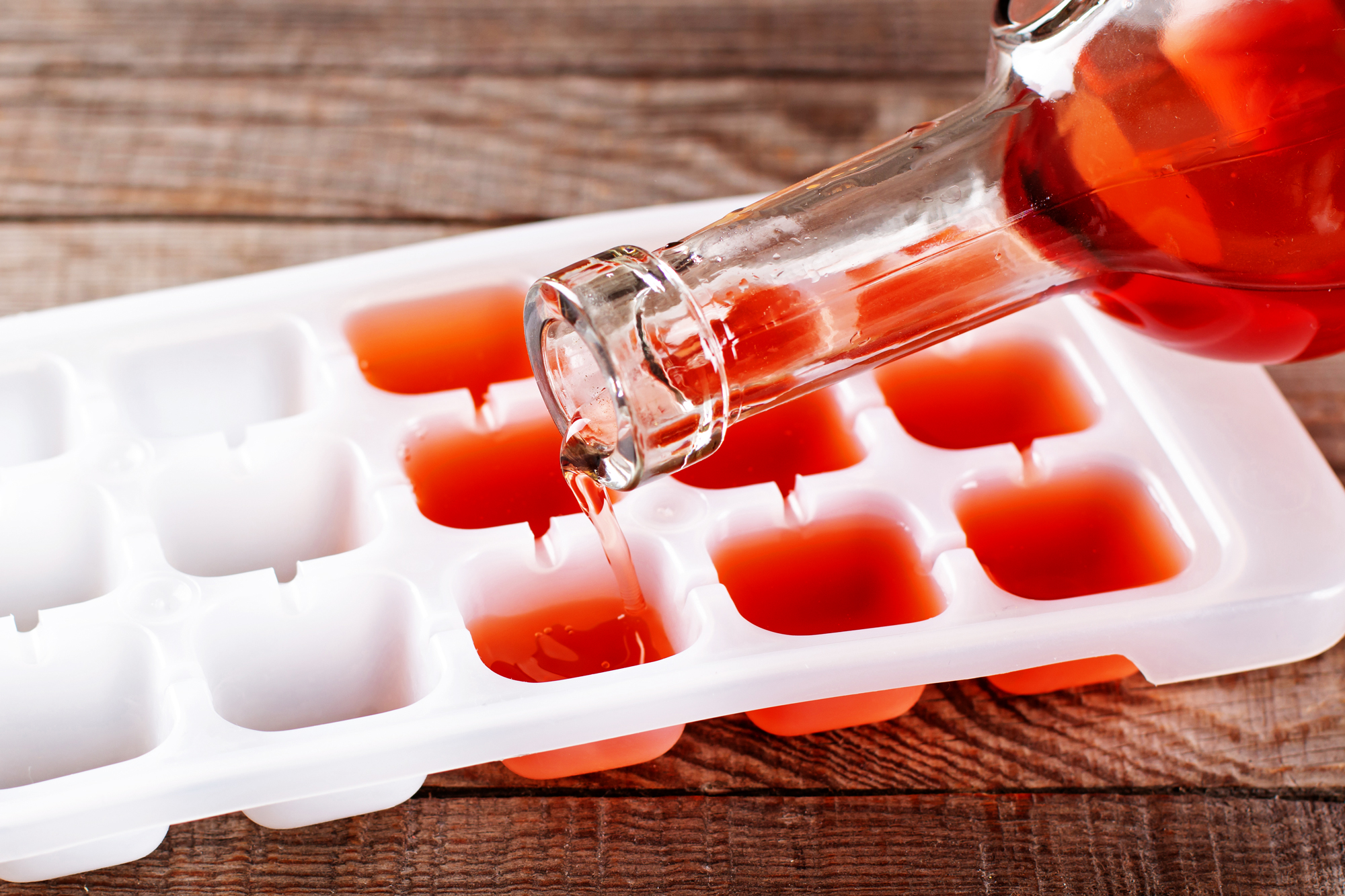 Pouring wine into ice cube tray