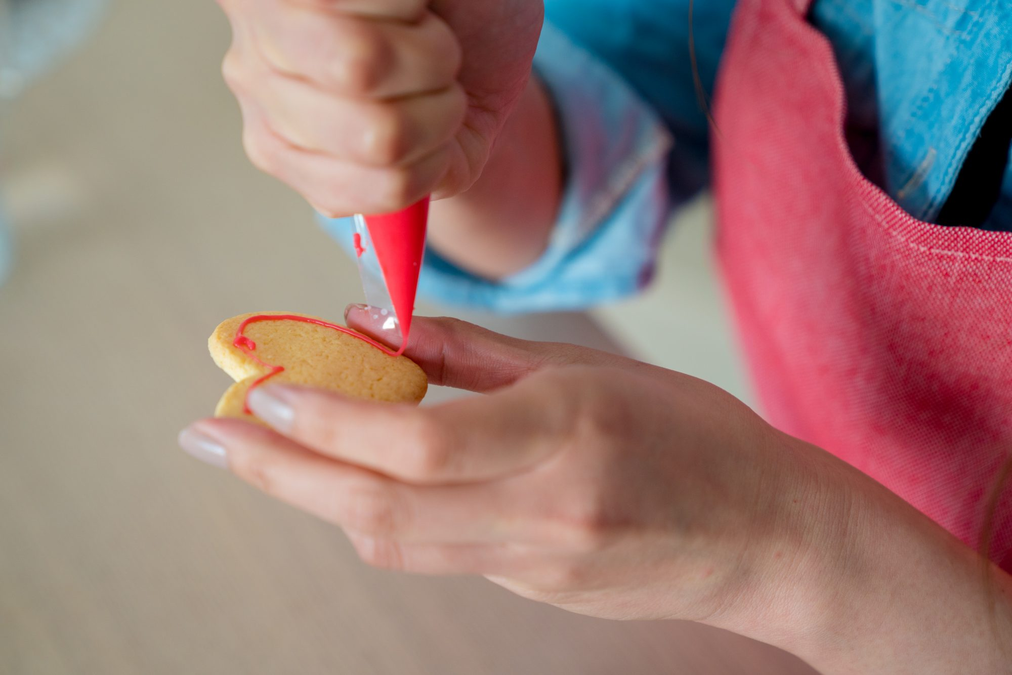 Close up of a woman icing a cookie