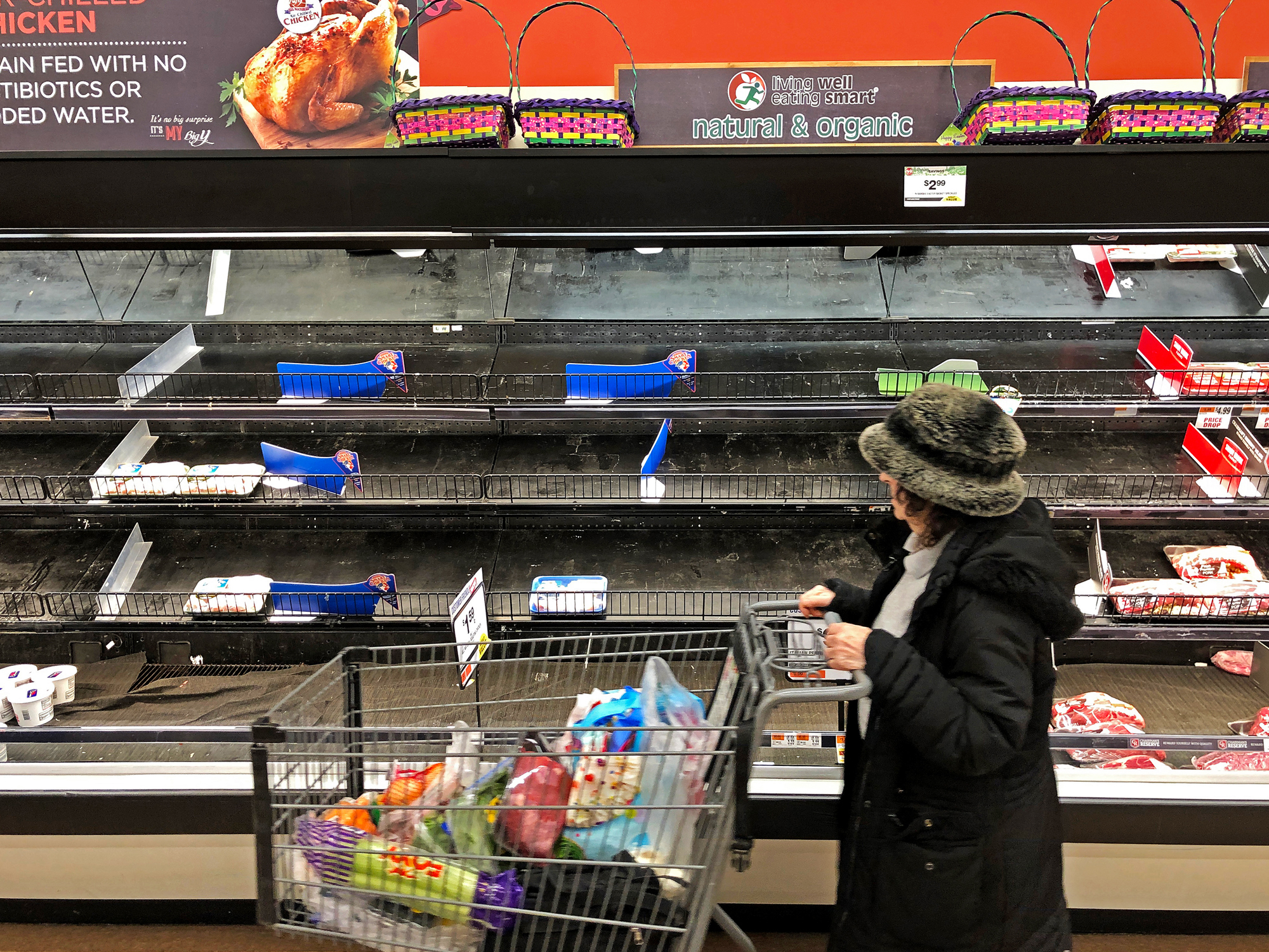 Meat shelves lay empty at a supermarket in Saugus, Massachusetts on March 13, 2020.