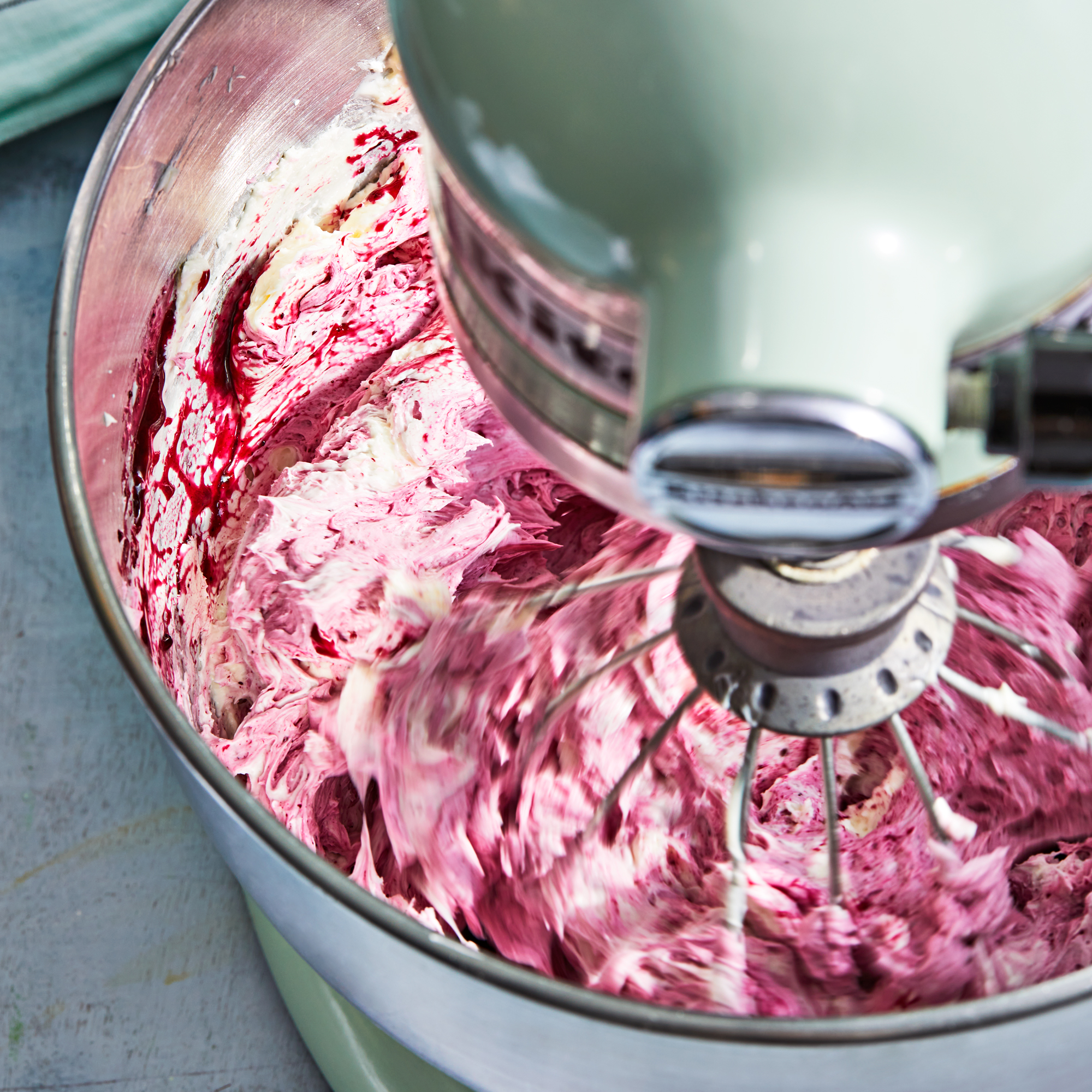 jam whipping into buttercream frosting
