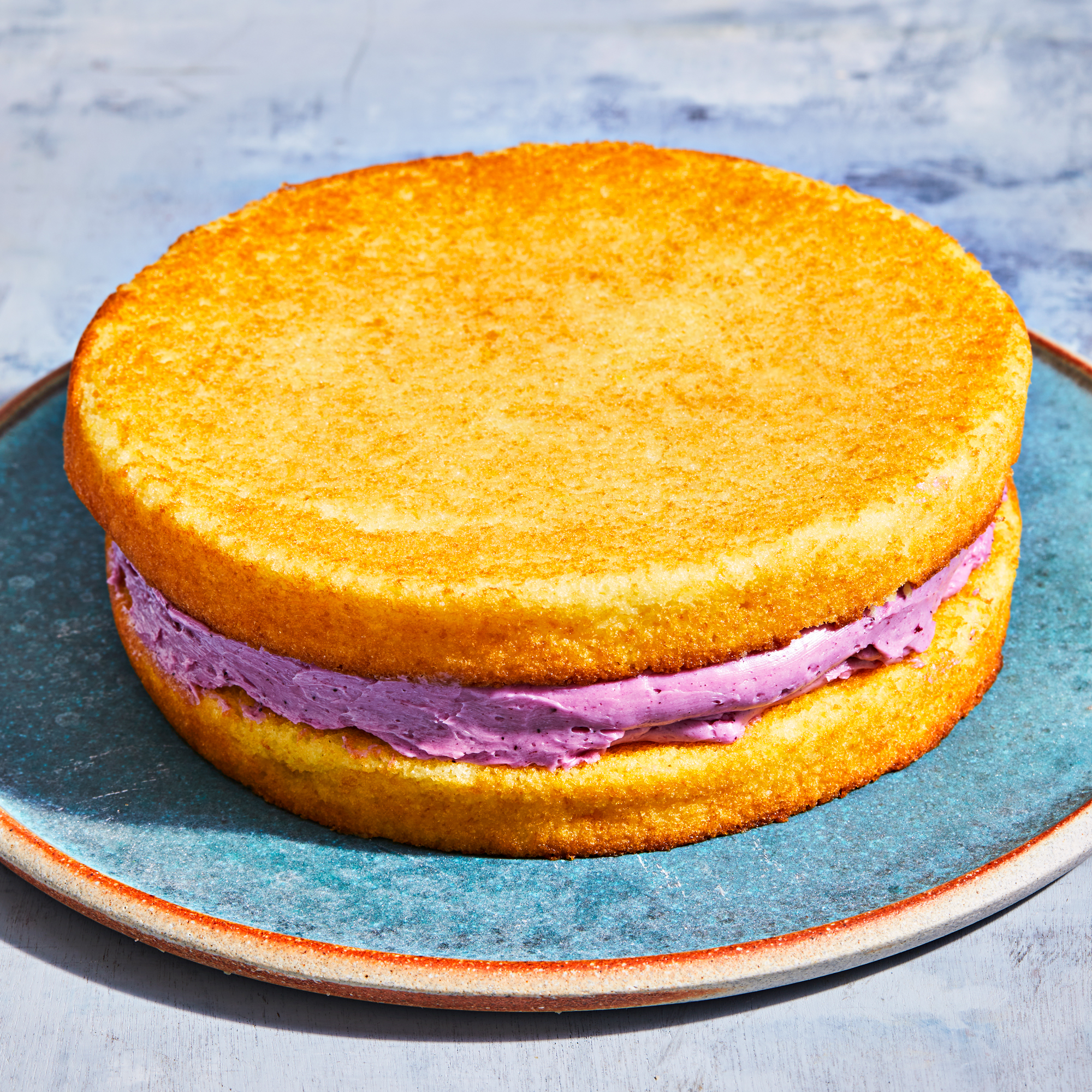 two cake layers with butter cream between