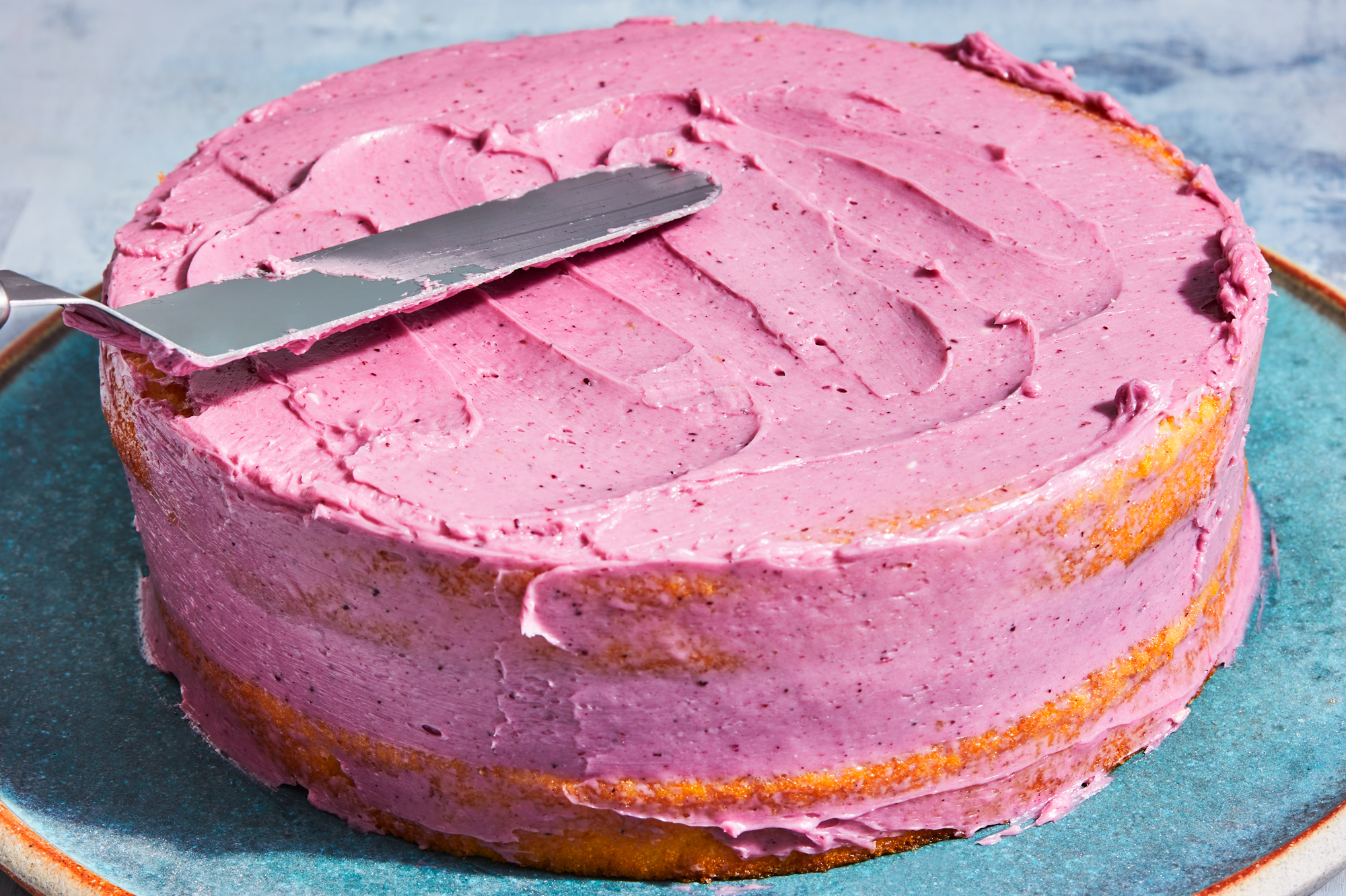 cake with blueberry coriander buttercream frosting