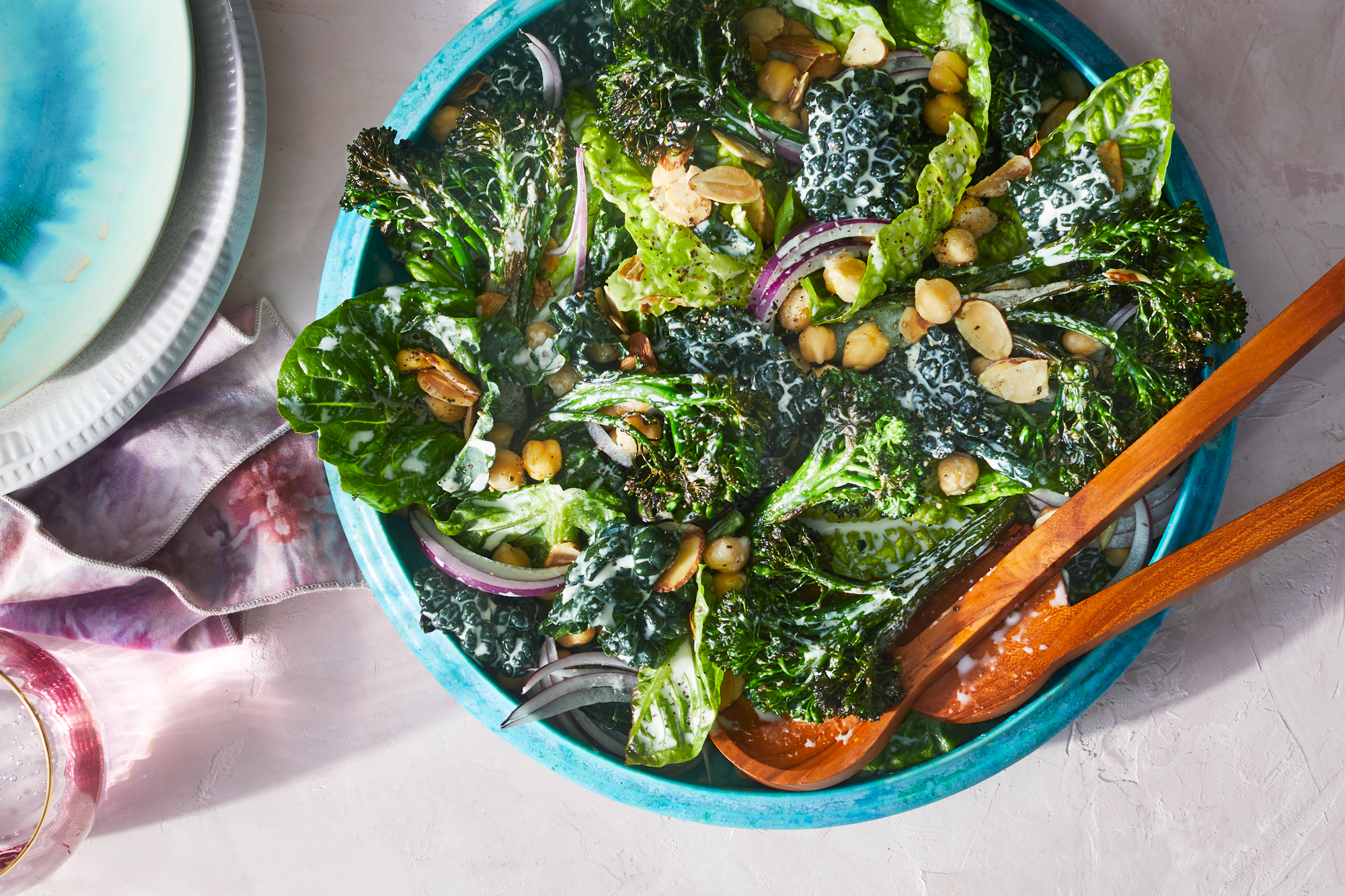 Serving bowl of charred broccolini caesar with kale and chickpeas