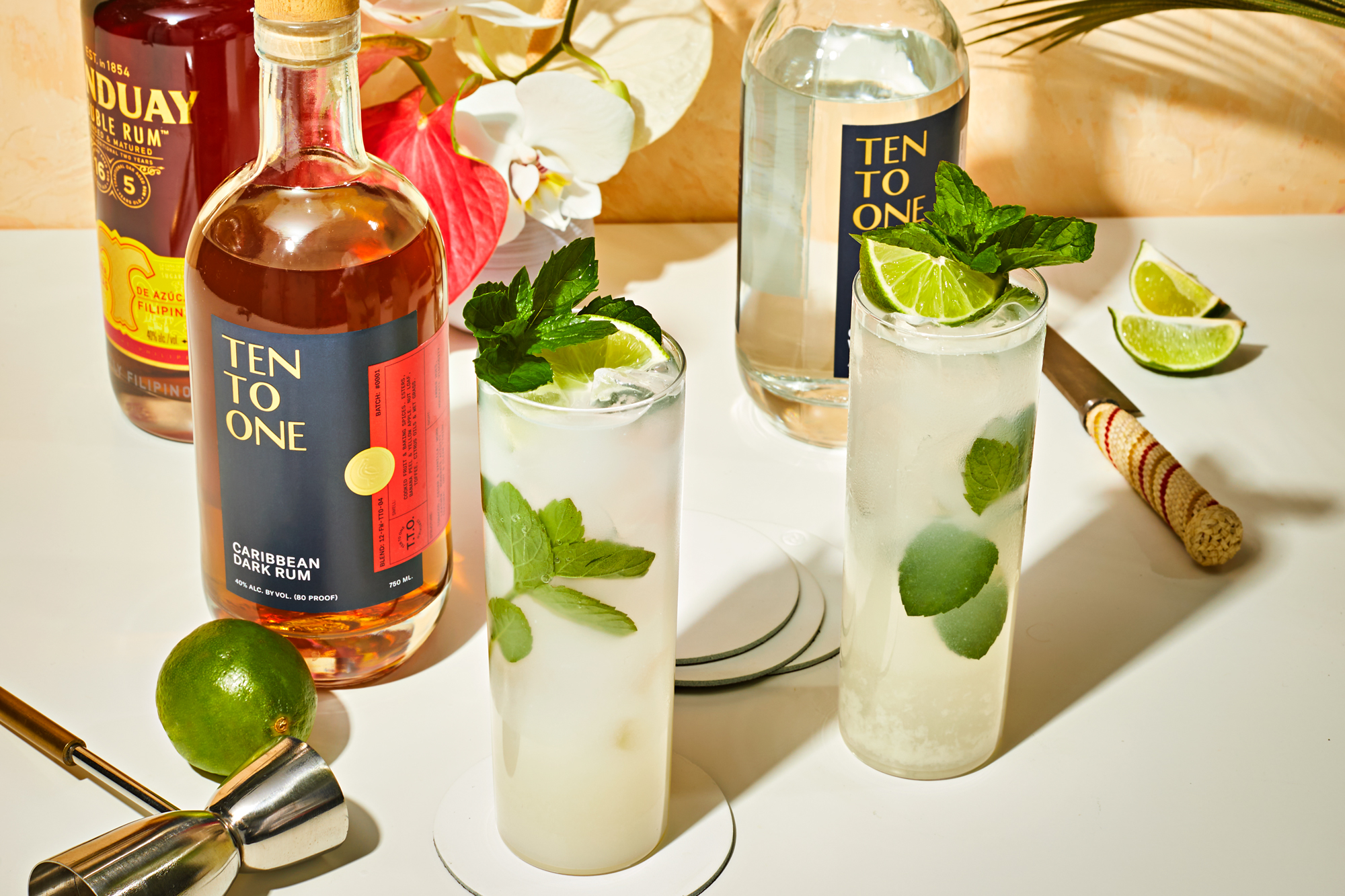 coconut mojitos with rum bottles