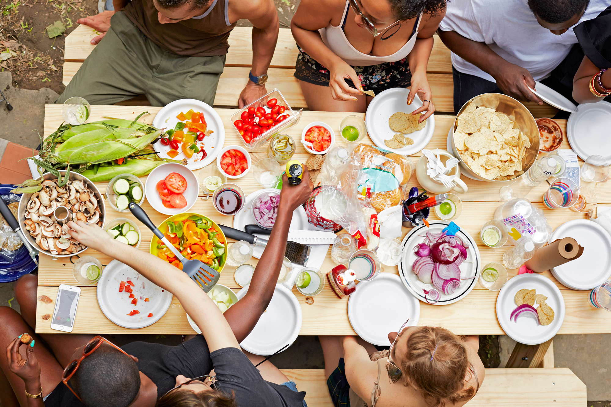 overhead shot of people eating at a picnic table