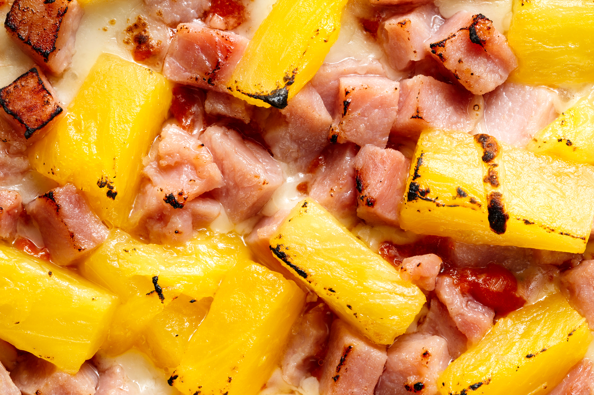 Close-up of a ham and pineapple pizza