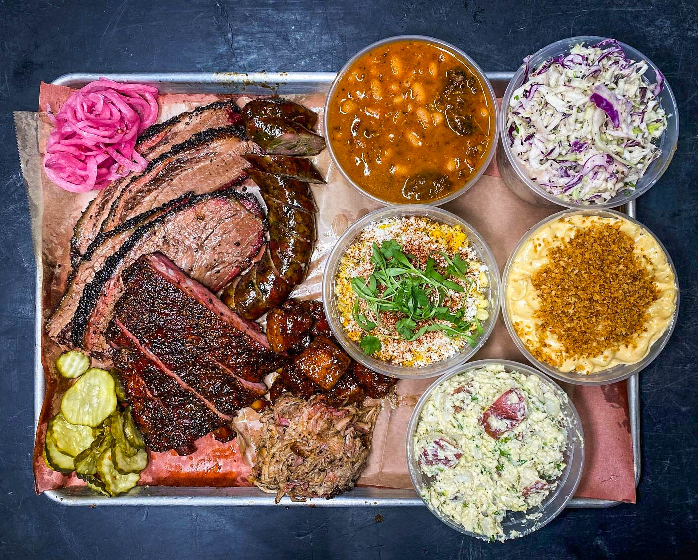 platter of barbecue and sides from Moo's Craft Barbecue