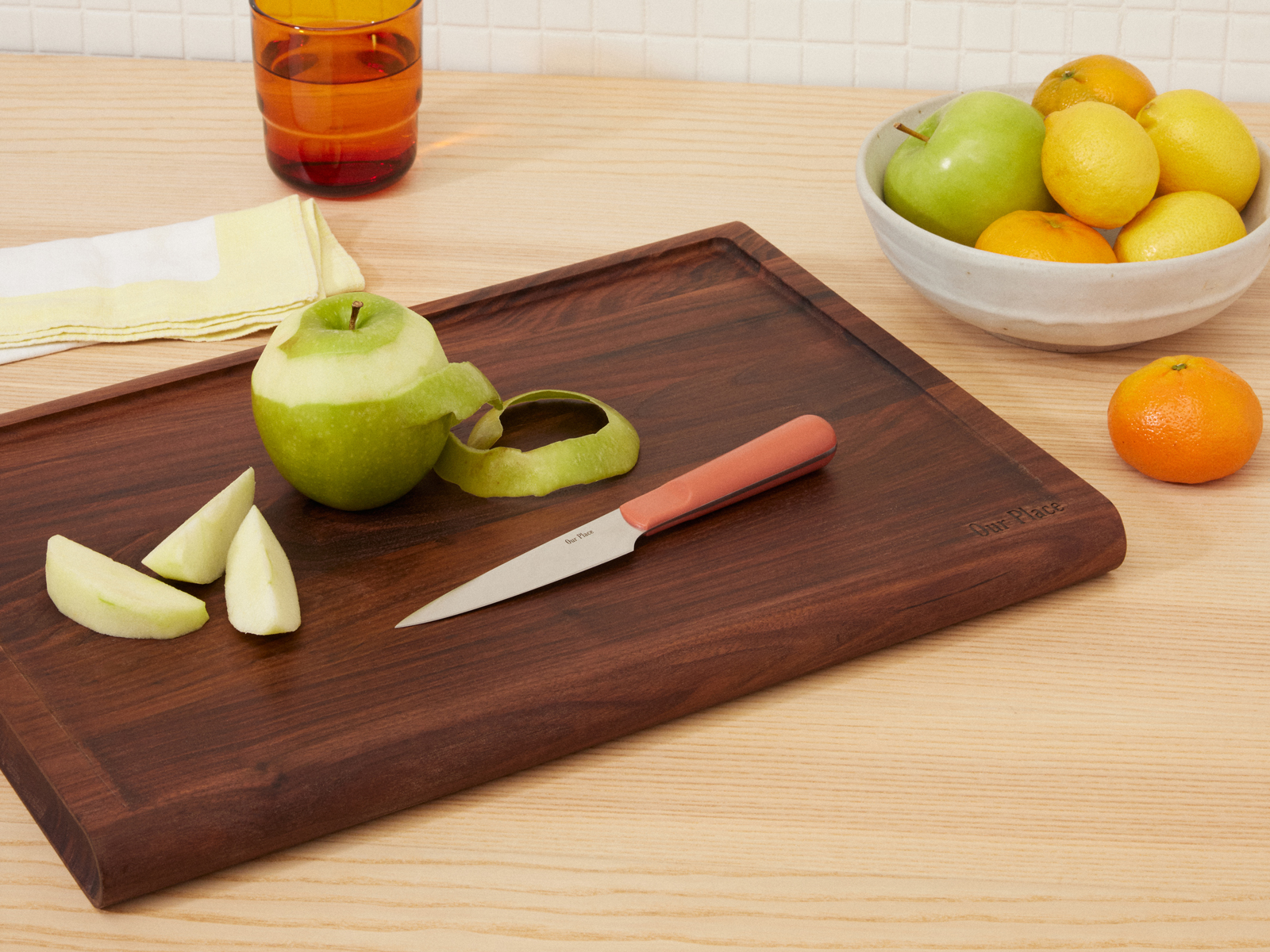 Our Place walnut cutting board and paring knife