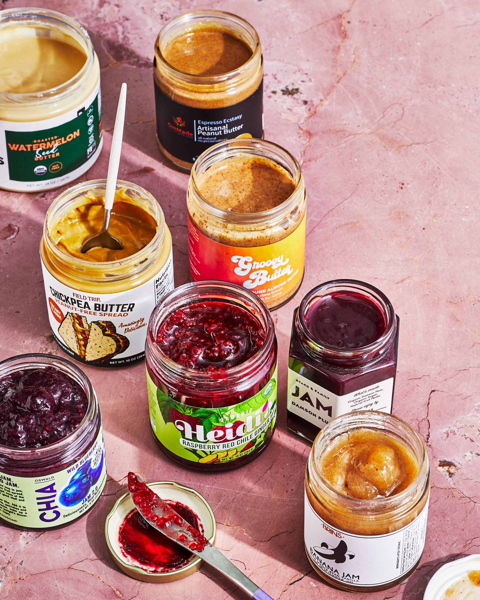 jars of jam and nut and seed butters