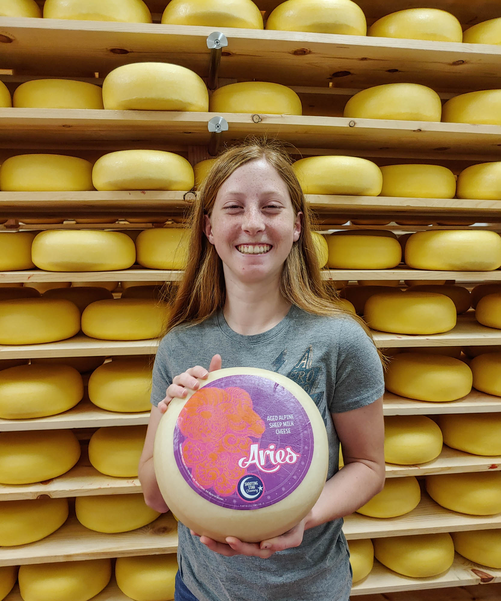 Avery of Shooting Star Creamery, holding Aries cheese