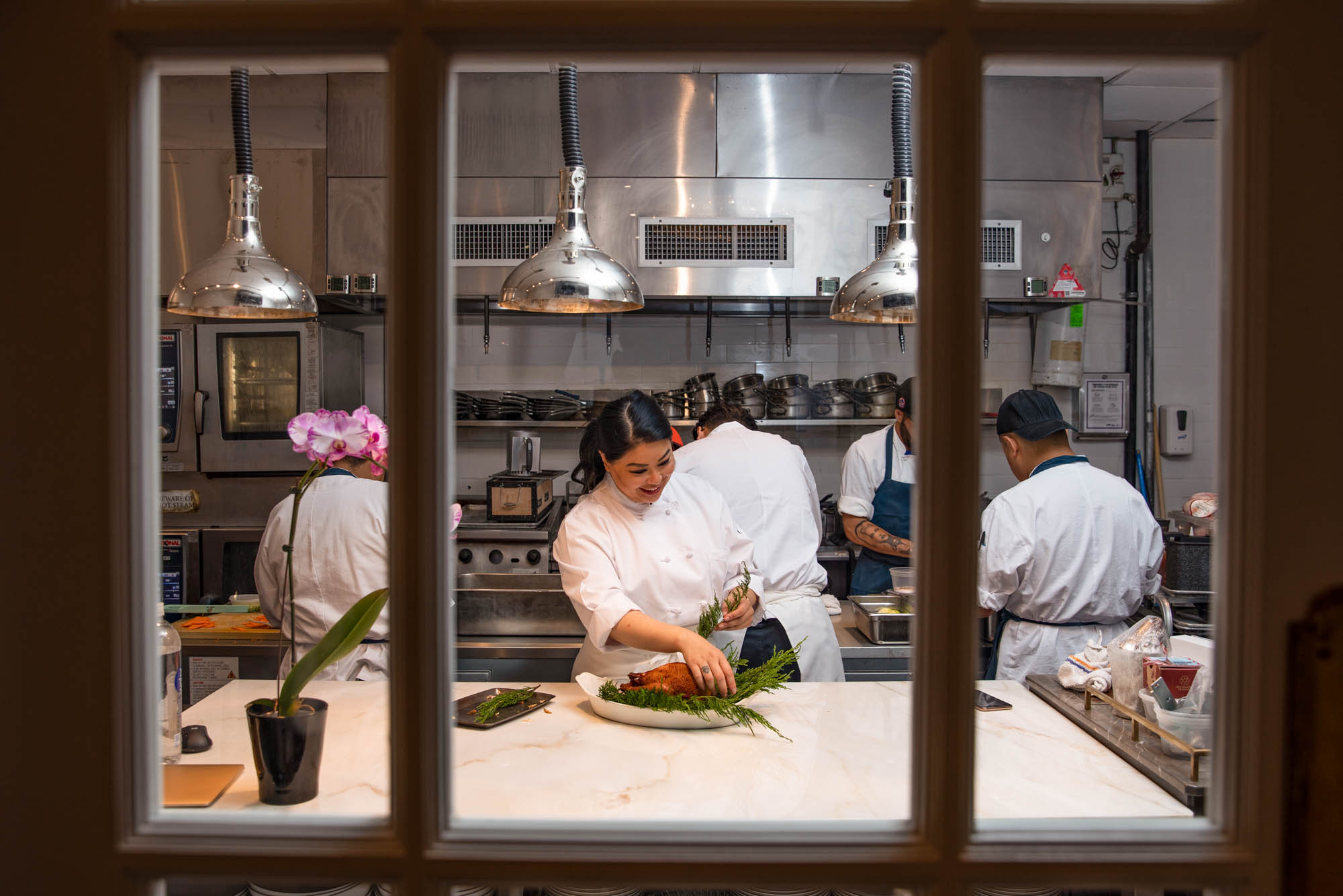 Angie Mar in the kitchen at Les Trois Chevaux