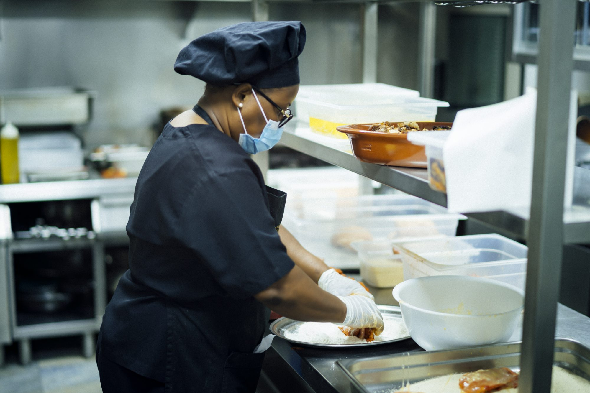 solidarity chef preparing food for those most in need due to the economic crisis