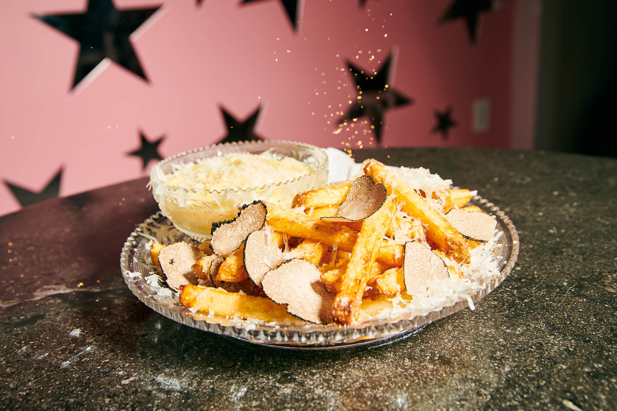 sprinkling edible gold dust on the most expensive fries