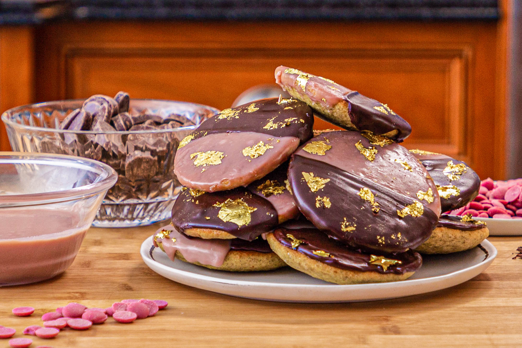 plate of NY Ruby Rye Blacka nd White Cookies with gold leaf