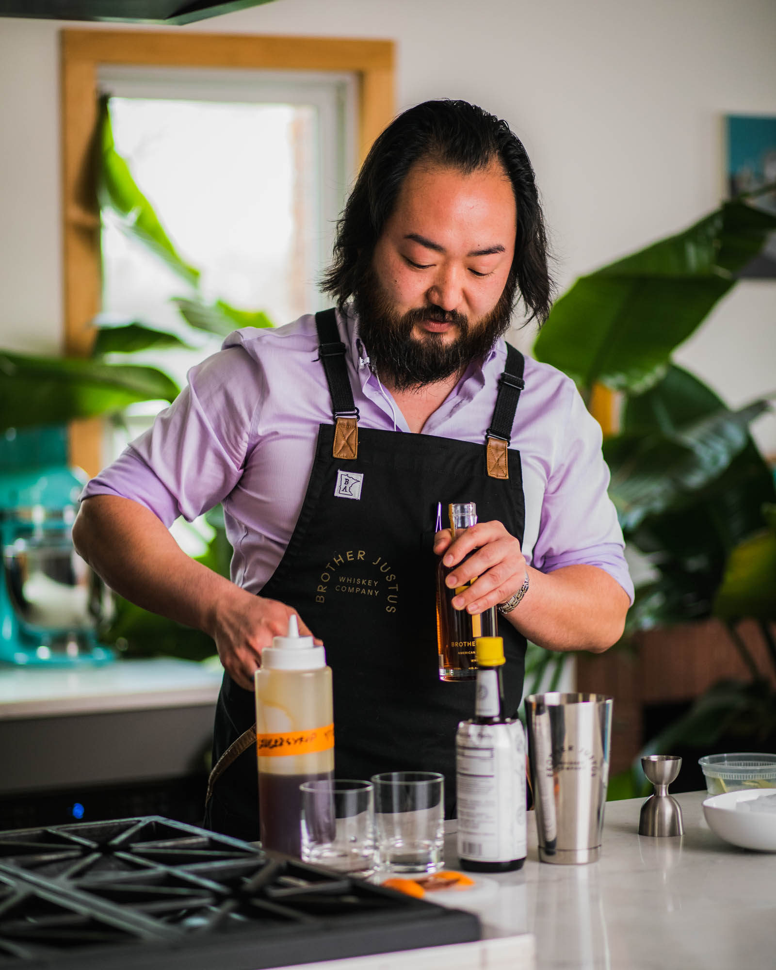 Jonathan Janssen making a soy-ginger old-fashioned