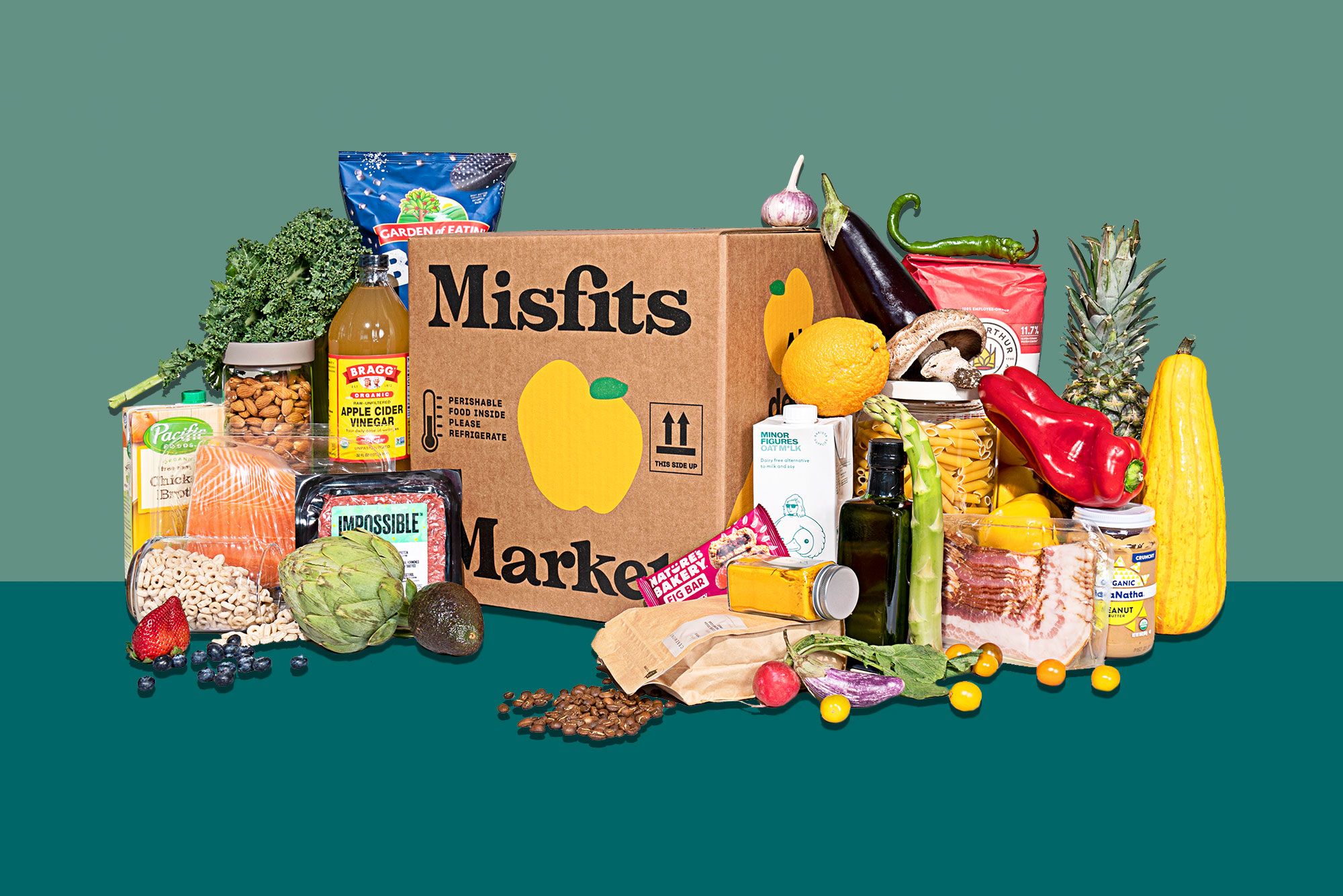 Misfits Market box with produce and other products alongside
