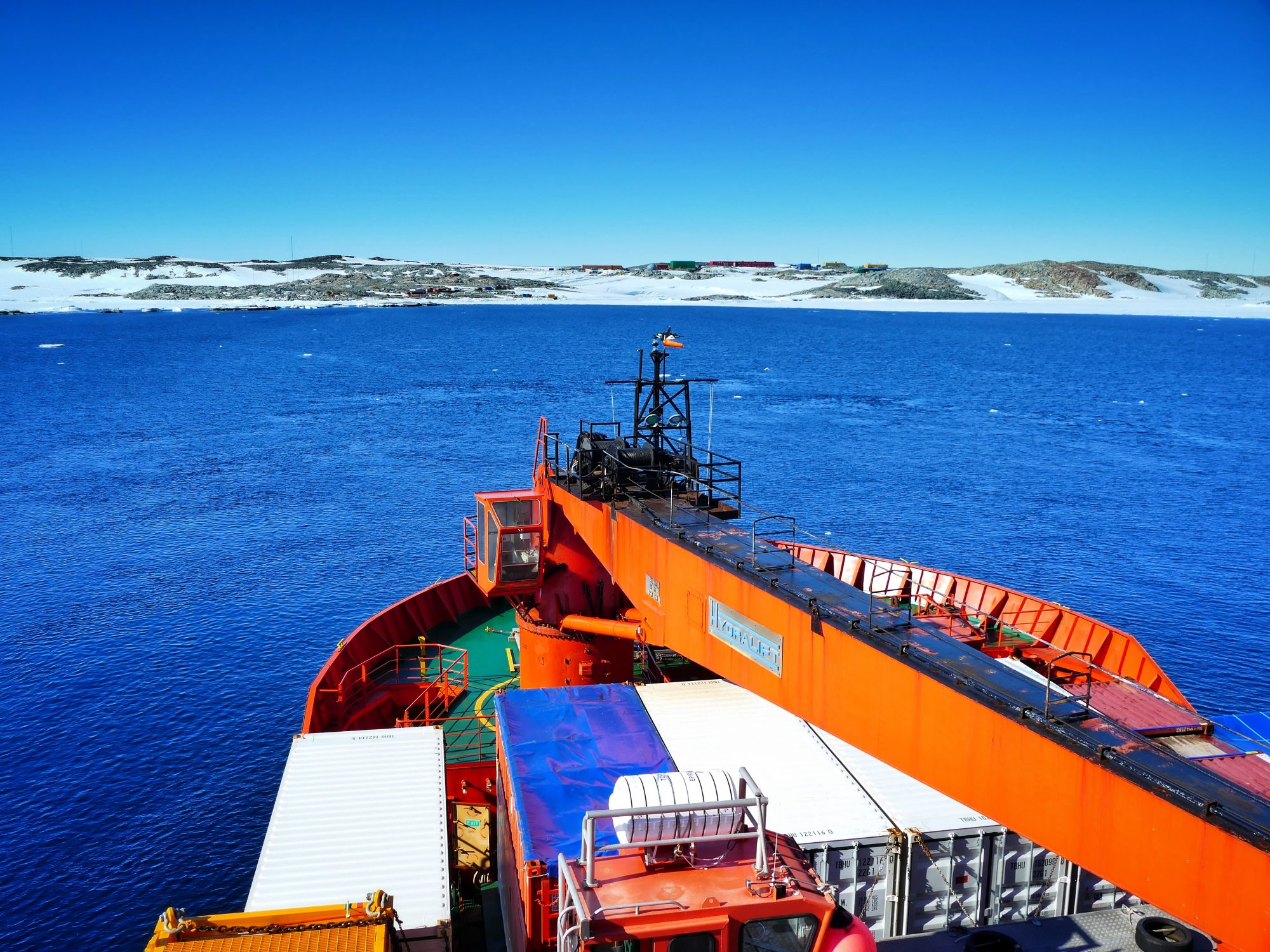 View over deck of icebreaker approaching Casey Station, Antarctica