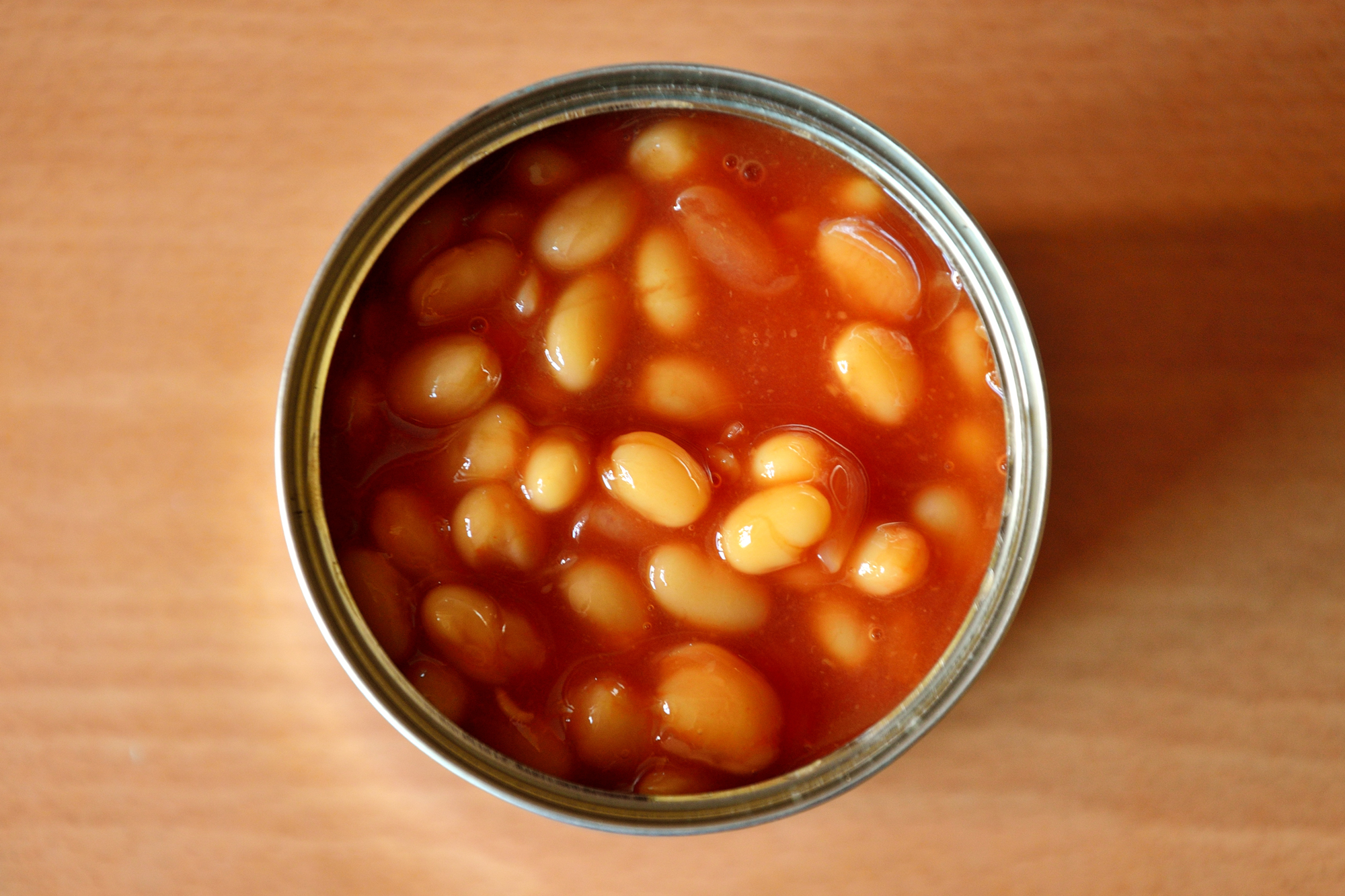 overhead image of open can of baked beans