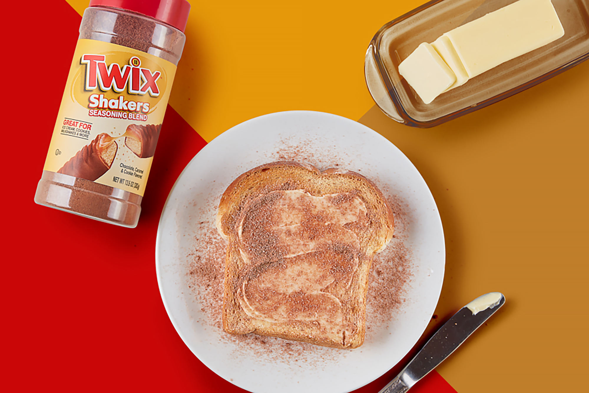 Twix Seasoning Blend with buttered toast and a butter stick on a serving plate