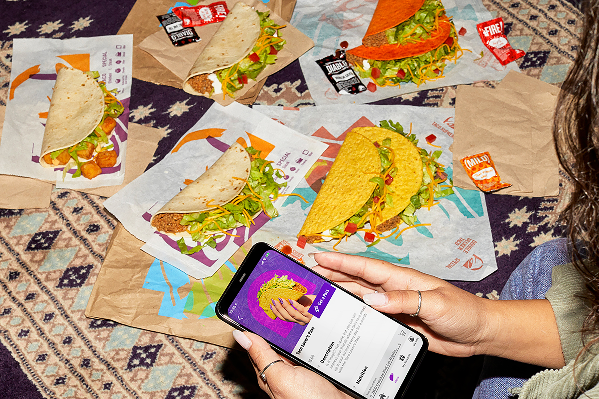 A Taco Bell customer using the new Taco Lover's Pass