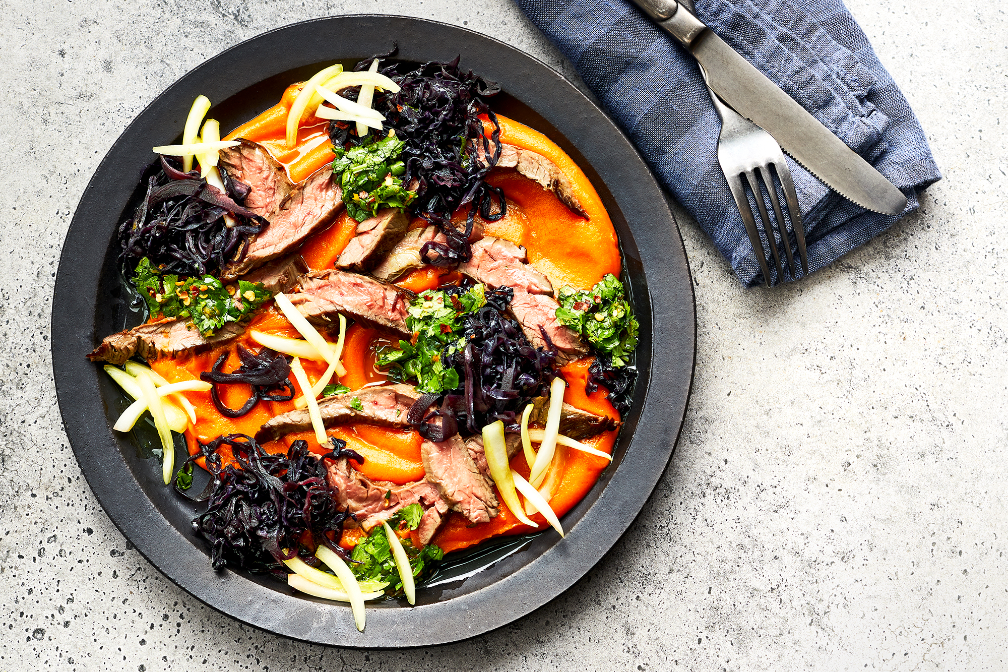 Skirt Steaks with Carrot Puree and Braised Cabbage