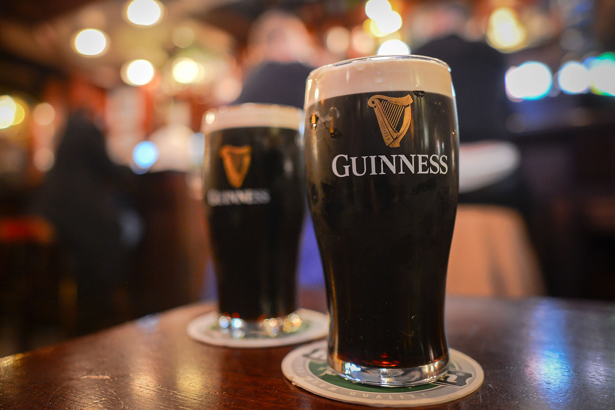 Two pints of Guinness in a taproom