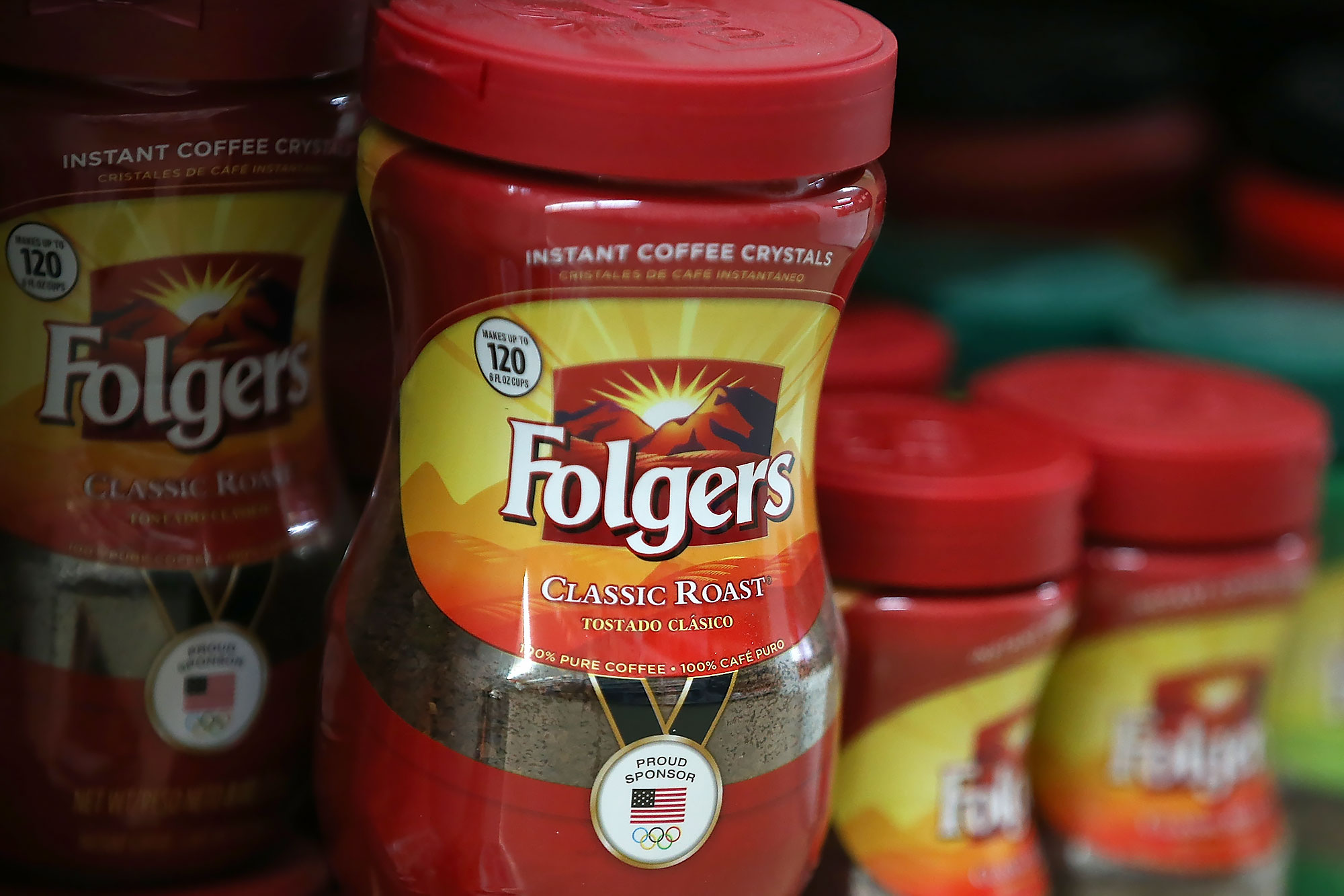 Packages of Folgers coffee are displayed on a shelf at a grocery store
