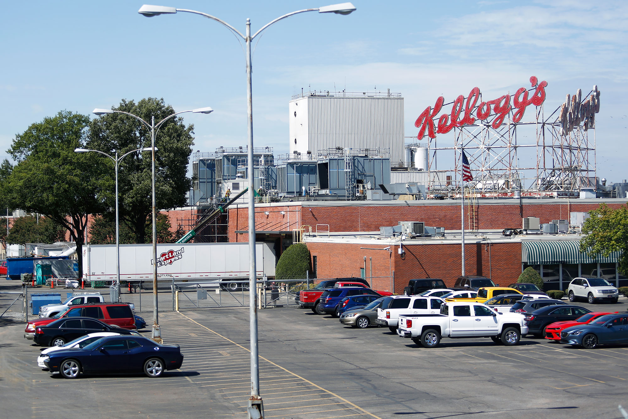 Vehicles sit parked outside of the Kellogg Co. cereal plant in Memphis, Tennessee, U.S