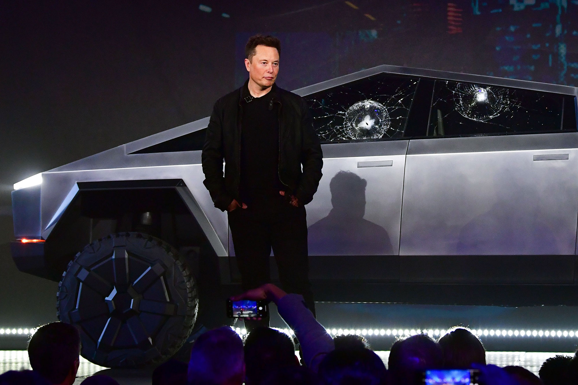 Elon Musk stands in front of the newly unveiled Tesla's Cybertruck at Tesla Design Center