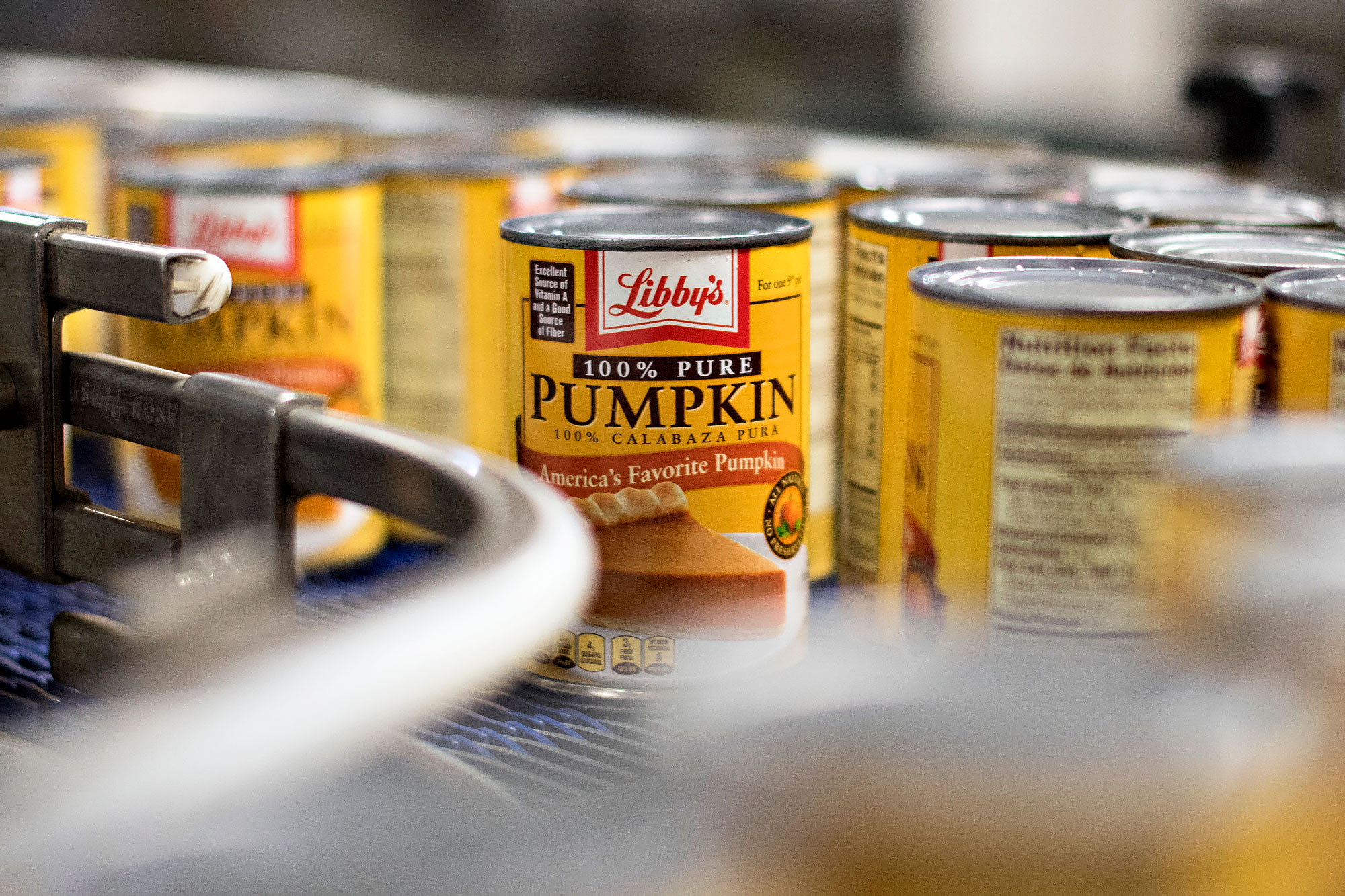 Cans of Libby's Pumpkin travel on a conveyor at the Nestle USA Libby's processing facility in Morton, Illinois, U.S.