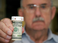 senior-man-perscription-bottle-money