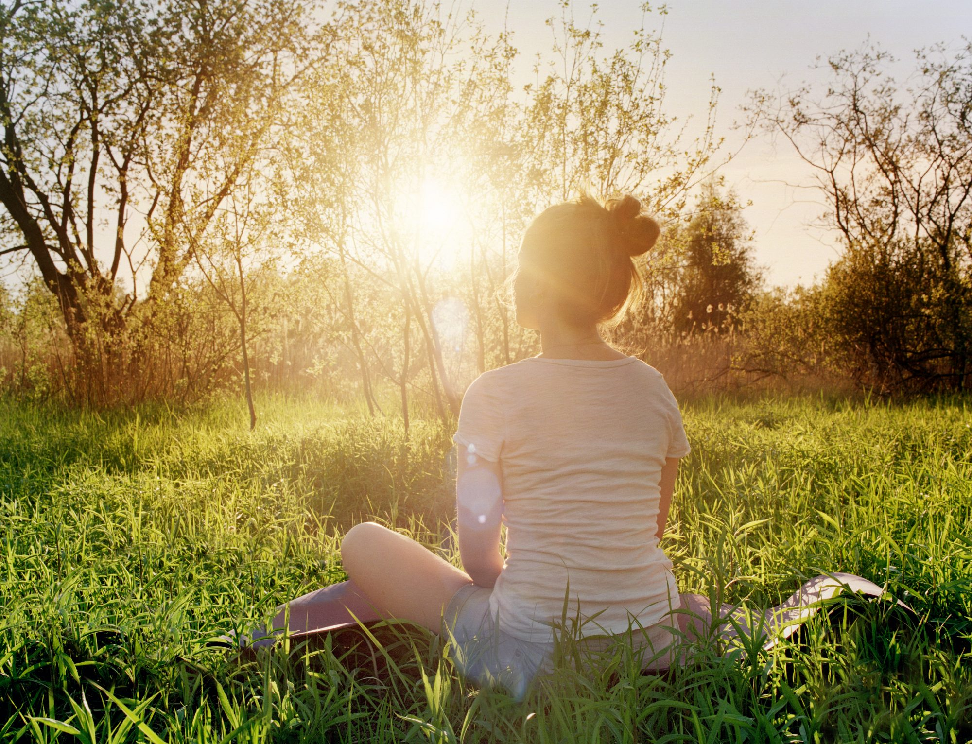 meditation-outdoors-sun-field