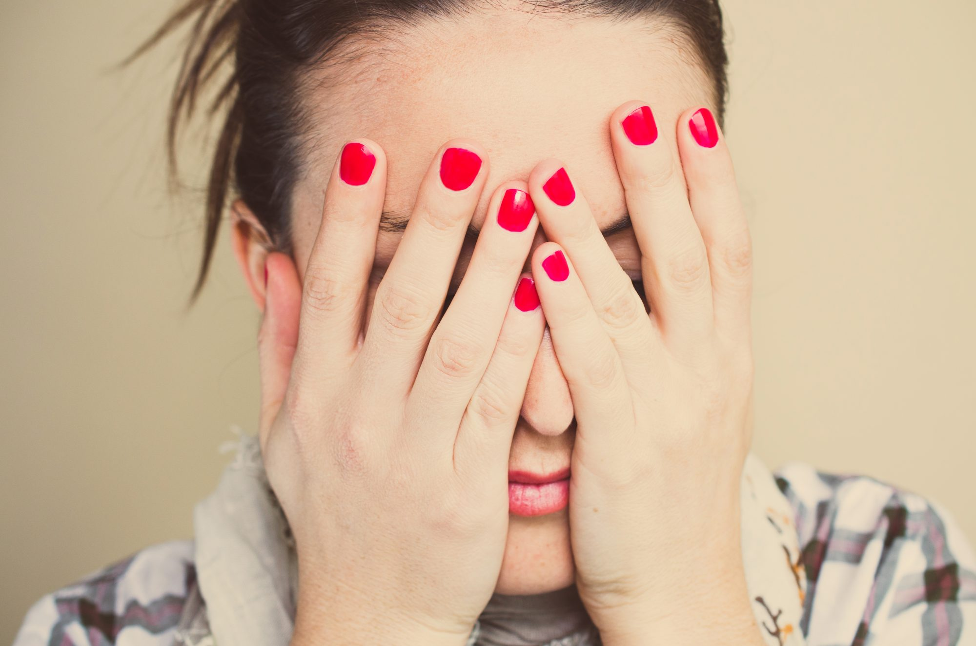 woman-cover-face-manicures-shy